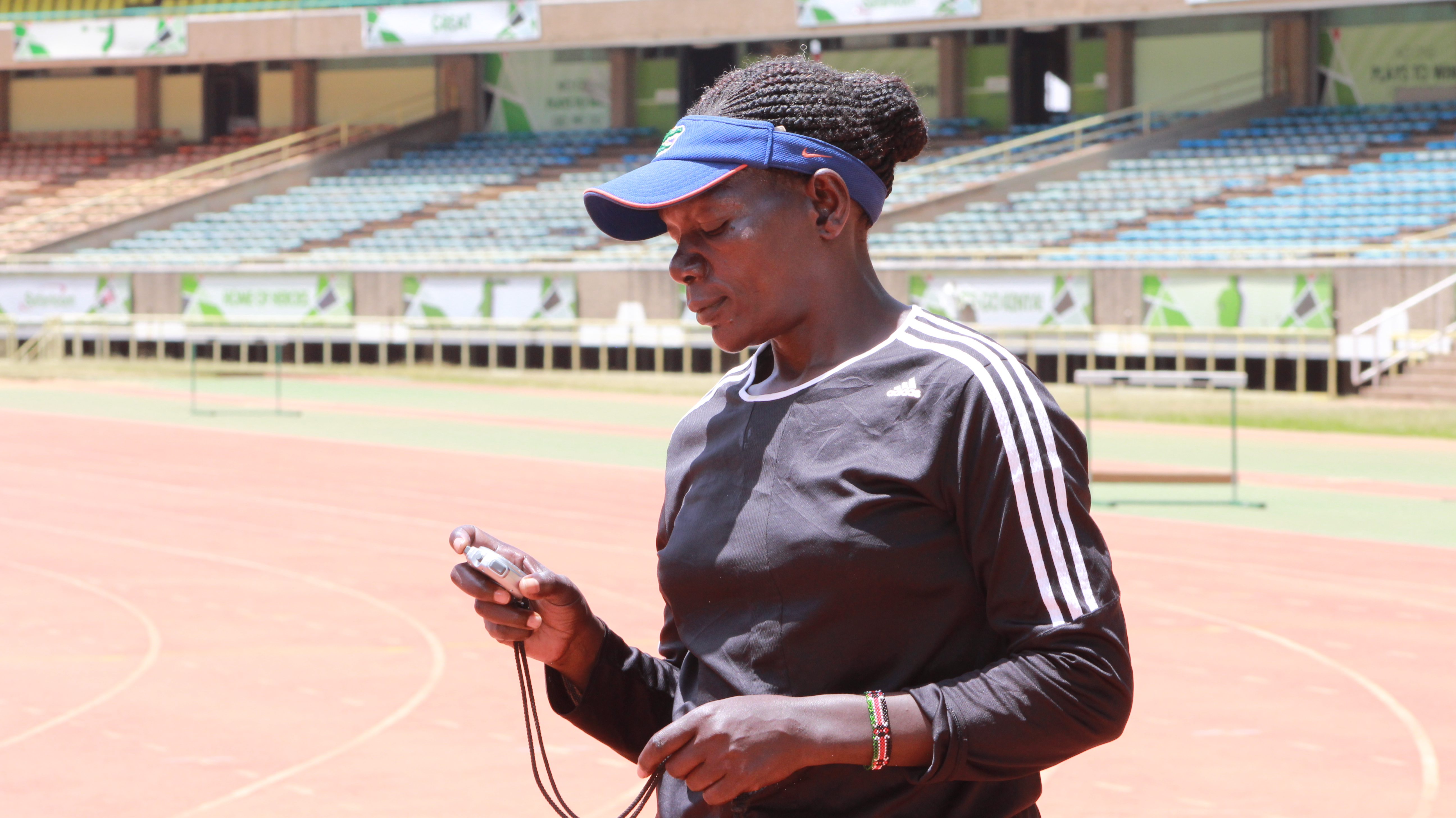 Coach Caroline Kola hopes her 32 young athletes will in their various events. (L. Ruvaga/VOA)