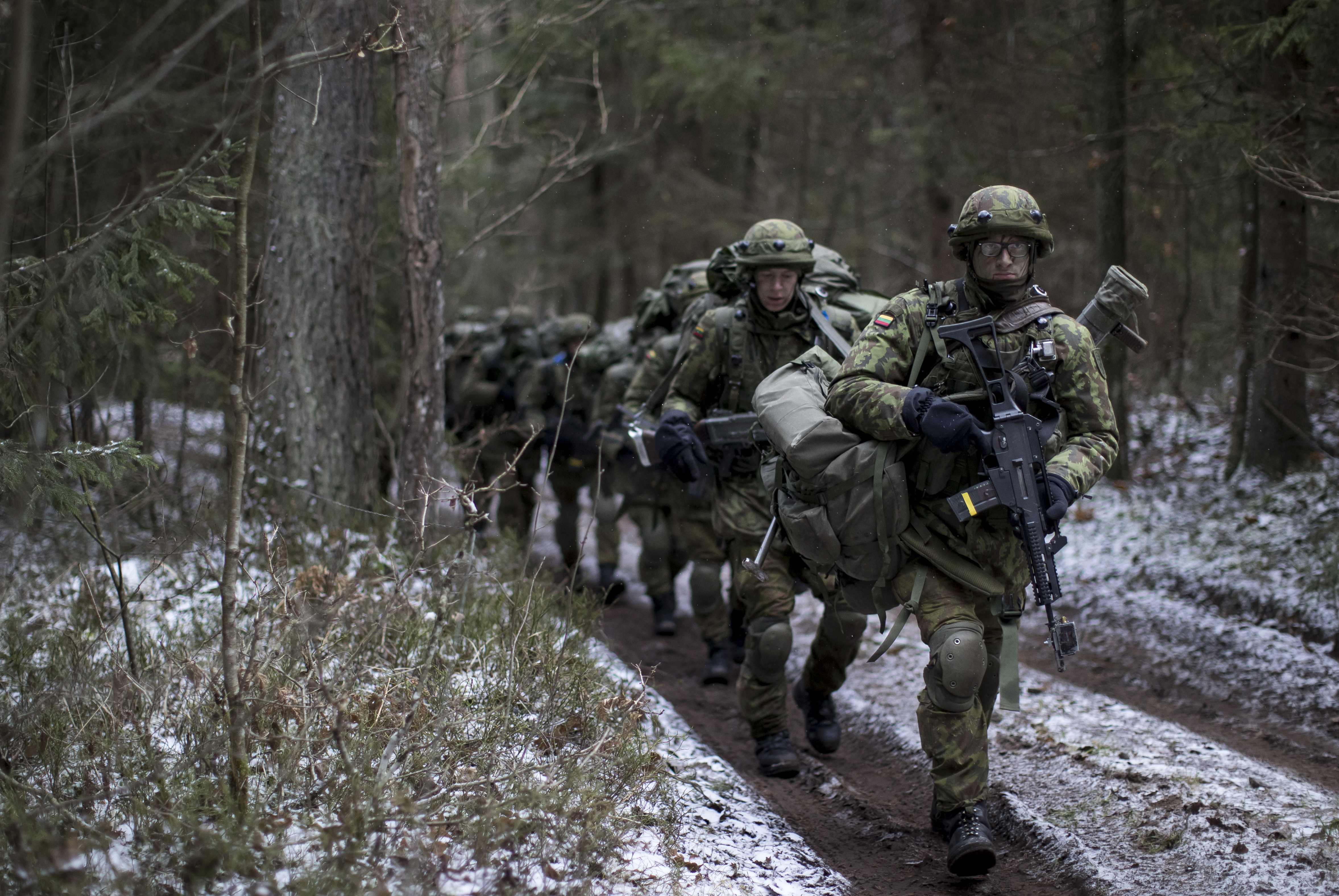 Lithuanian troops practice during a NATO military exercise, 'Iron Sword,' at the Rukla military base some 130 km. (80 miles) west of the capital Vilnius, Lithuania, on Monday, Nov. 28, 2016. (AP Photo/Mindaugas Kulbis)