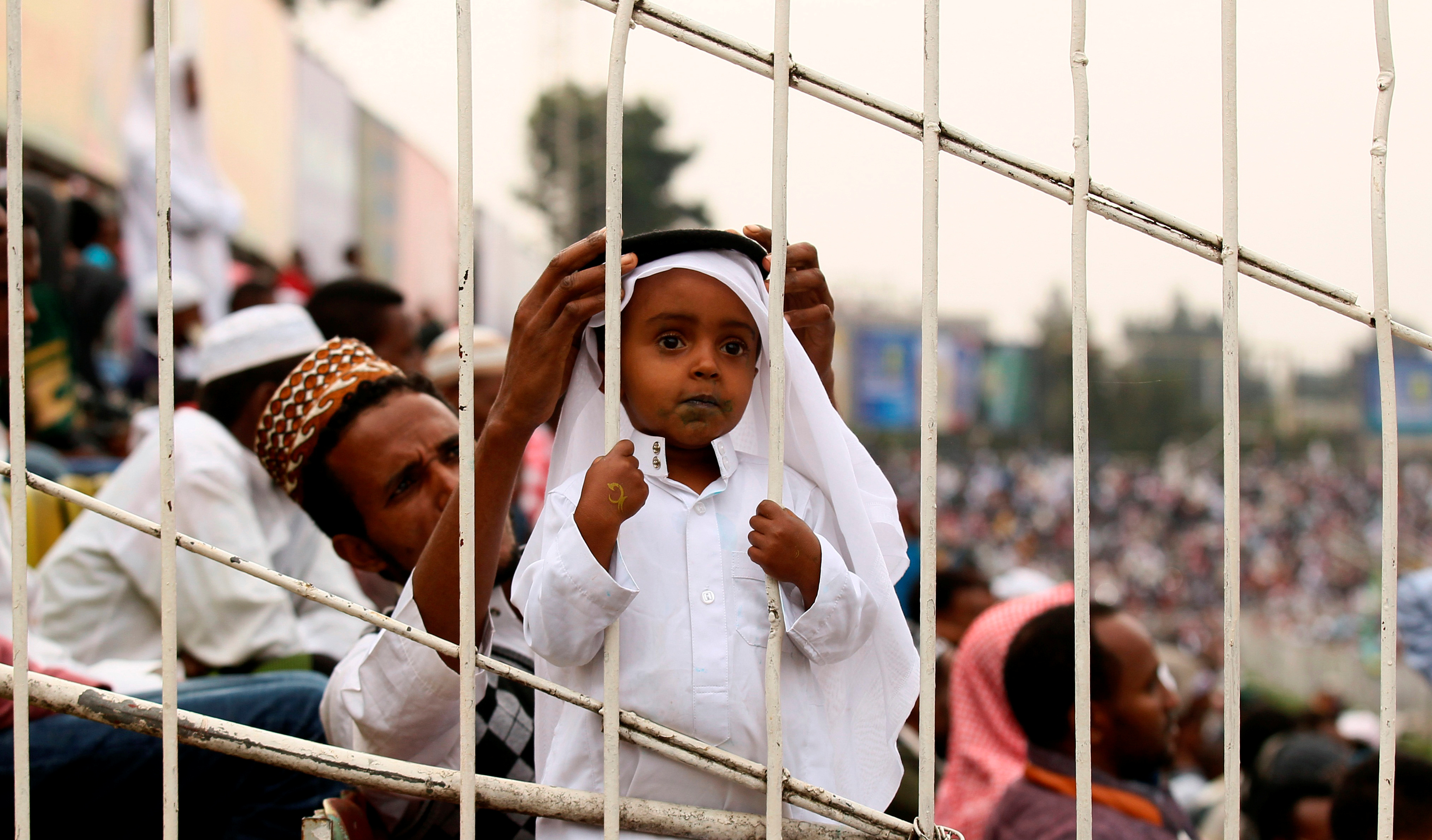 A Muslim boy attends Eid al-Fitr prayers to mark the end of the holy fasting month of Ramadan in Addis Ababa, Ethiopia July 6, 2016.