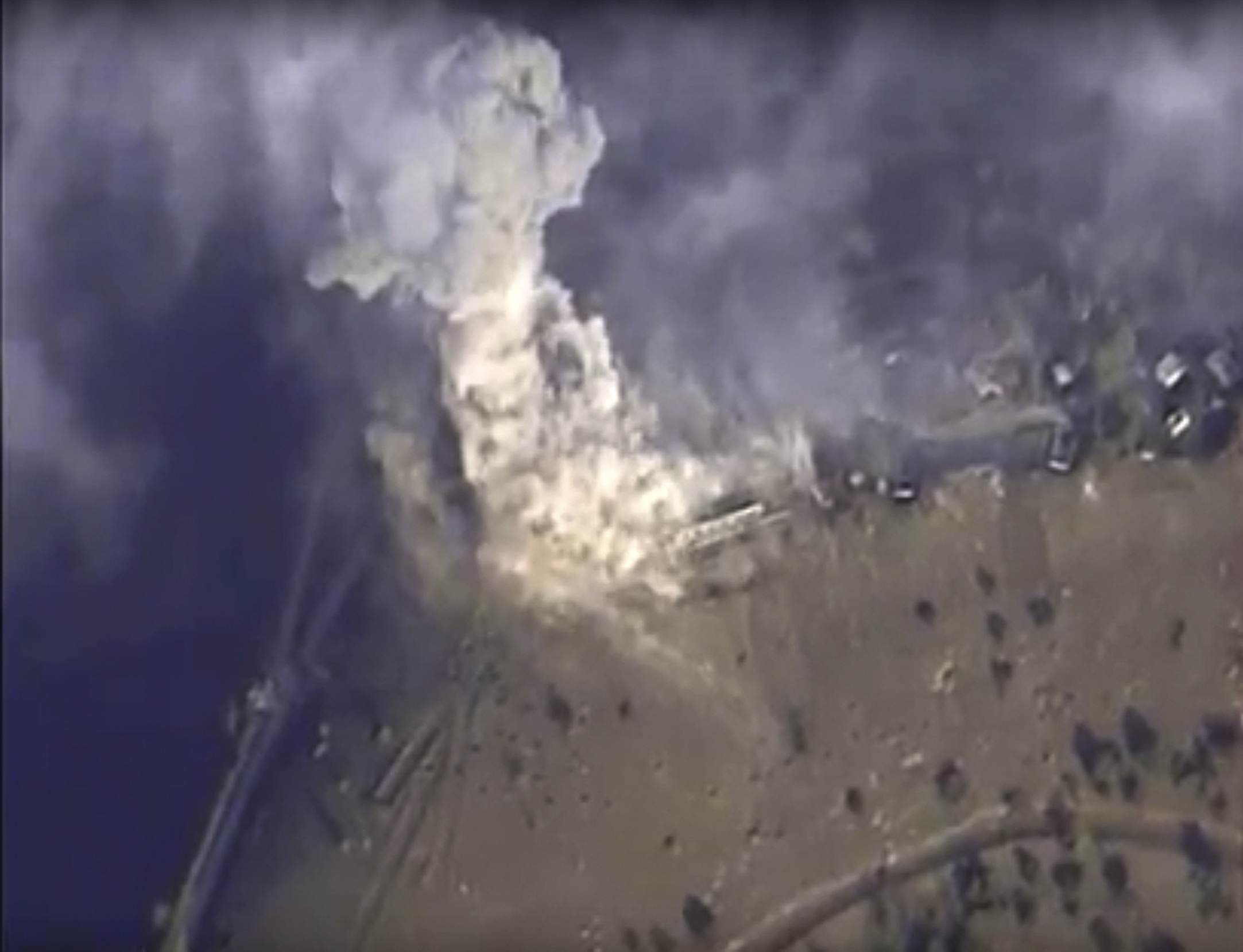 This photo made from footage taken from the Russian Defense Ministry official websiteNov. 2, 2015, shows a Russian airstrike hit a target in Syria. The Russian Defense Ministry said the strike was performed by an Su-34M bomber in Aleppo province.