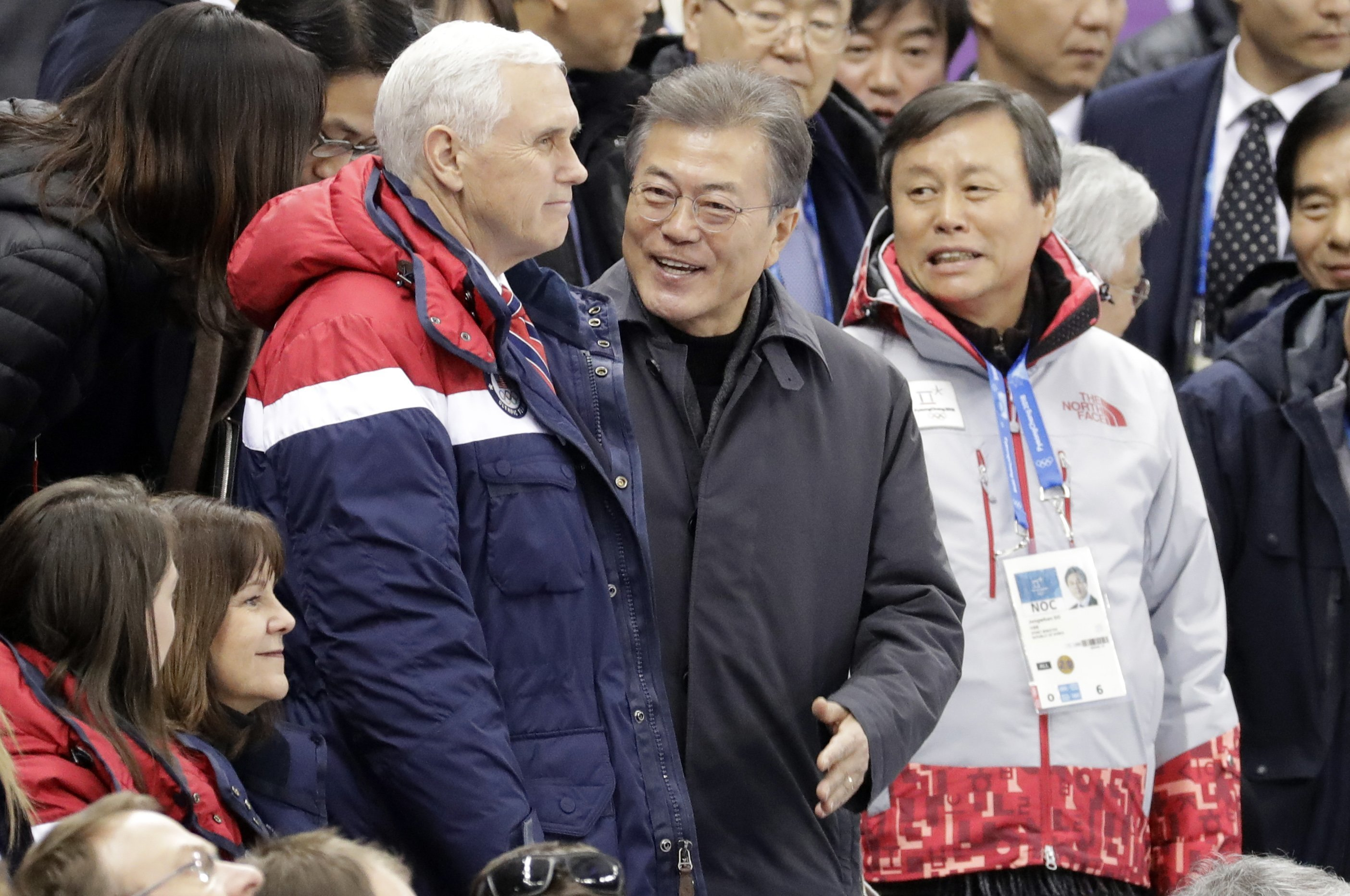 U.S. Vice President Mike Pence, center left, and South Korean President Moon Jae-in attend the women's 500 meters short-track speedskating in the Gangneung Ice Arena at the 2018 Winter Olympics in Gangneung, South Korea, Feb. 10, 2018.