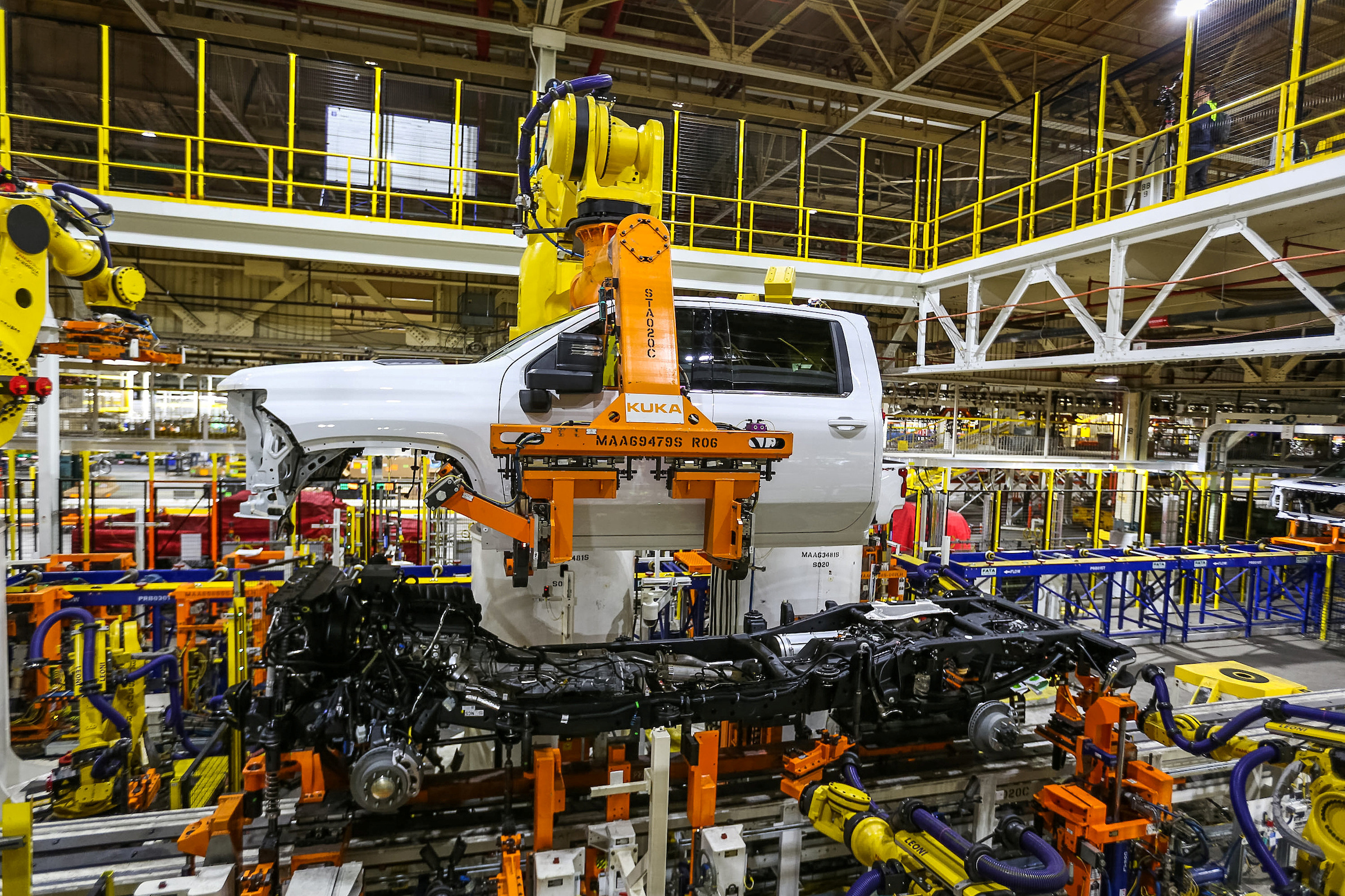 Robots swing a cab and bed into place for a new heavy duty pickup truck on the assembly line where Chevrolet Silverado trucks are being built at General Motors Flint Assembly in Flint, Michigan, Jan. 30, 2019.