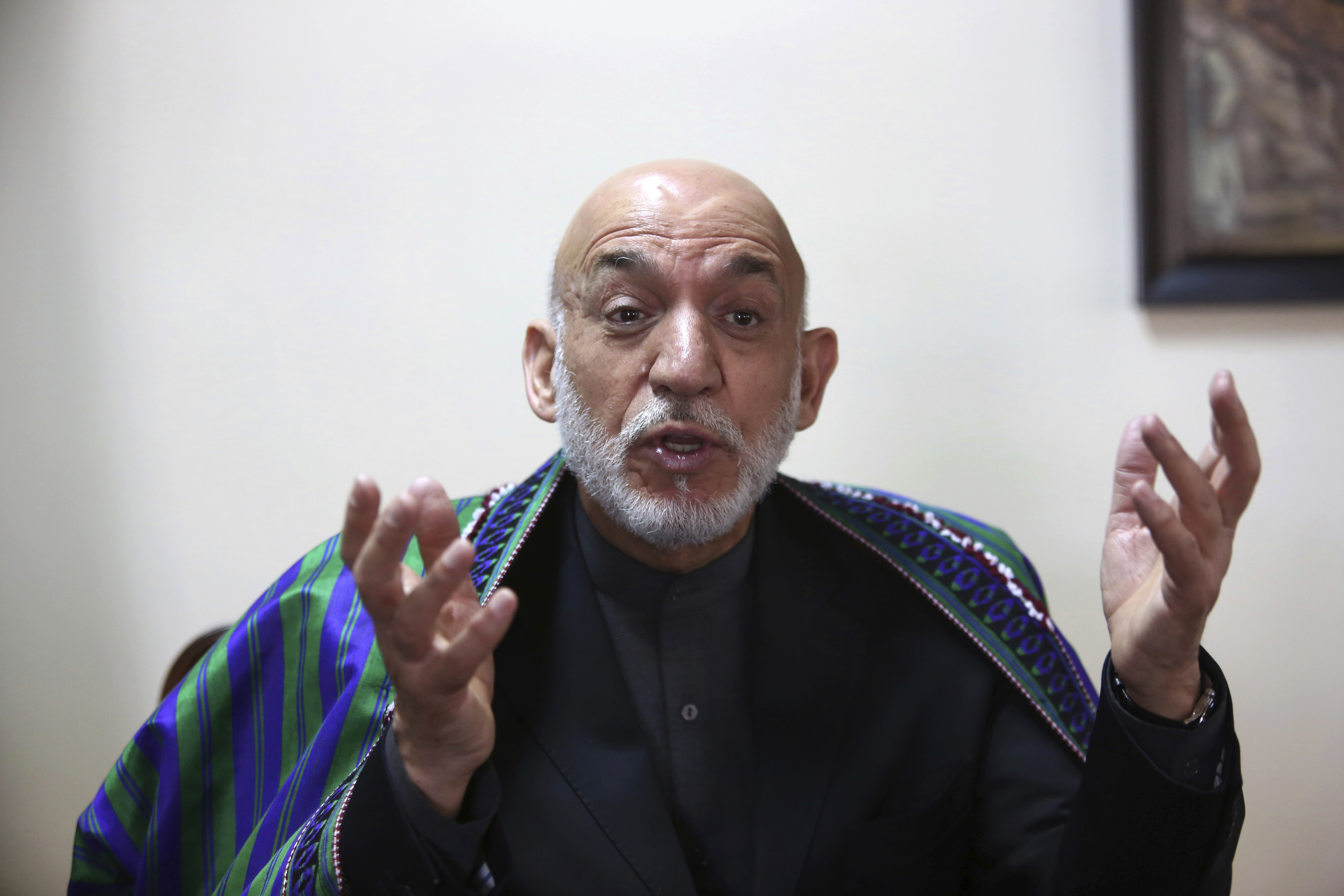 Former Afghan President Hamid Karzai speaks during an interview with the Associated Press in Kabul, Afghanistan, April 17, 2017.