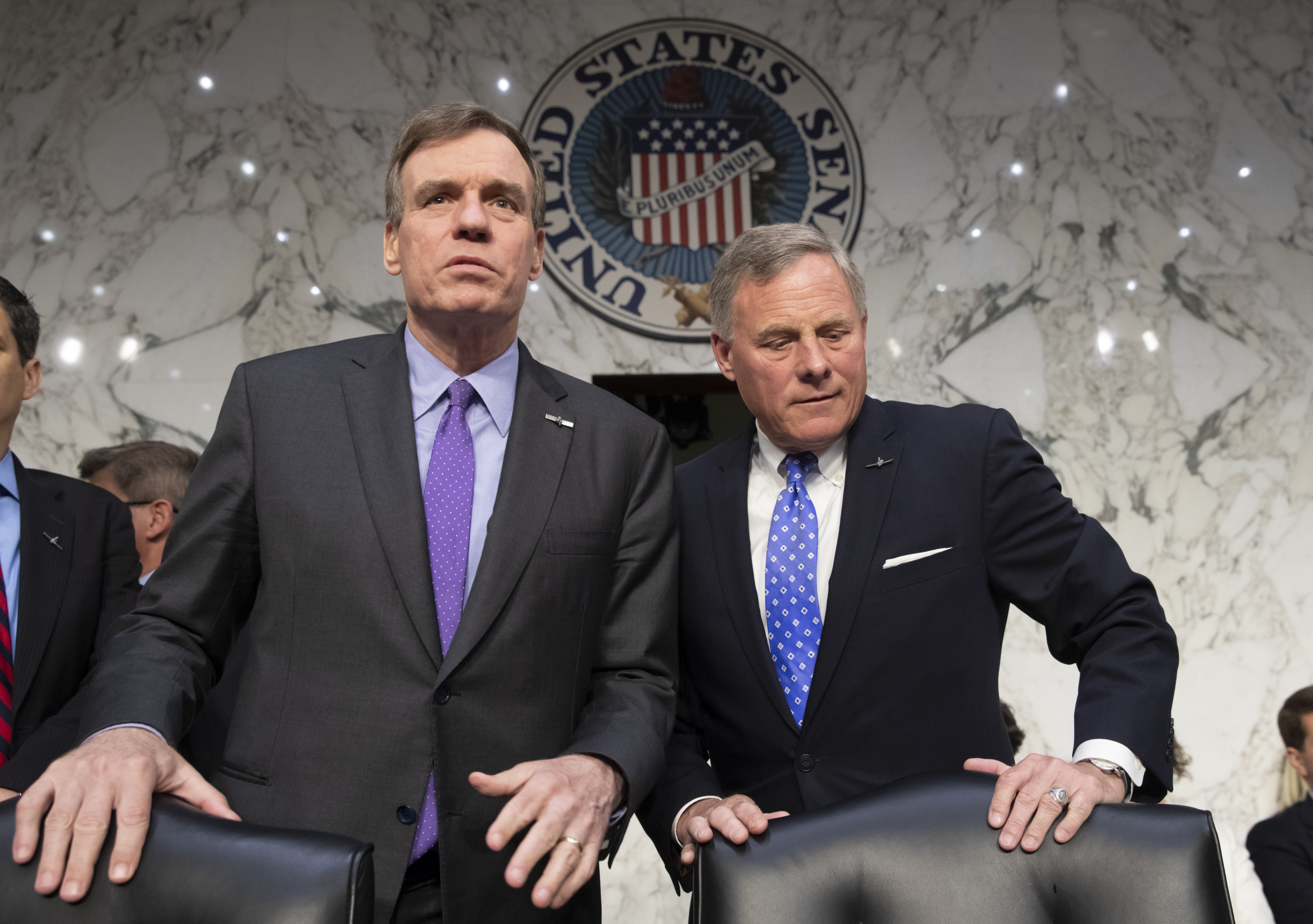 FILE - Senate Intelligence Committee Vice Chairman Mark Warner, D-Va., left, and Sen. Richard Burr, R-N.C., the panel chairman, are pictured prior to a hearing on Capitol Hill in Washington, May 9, 2018.