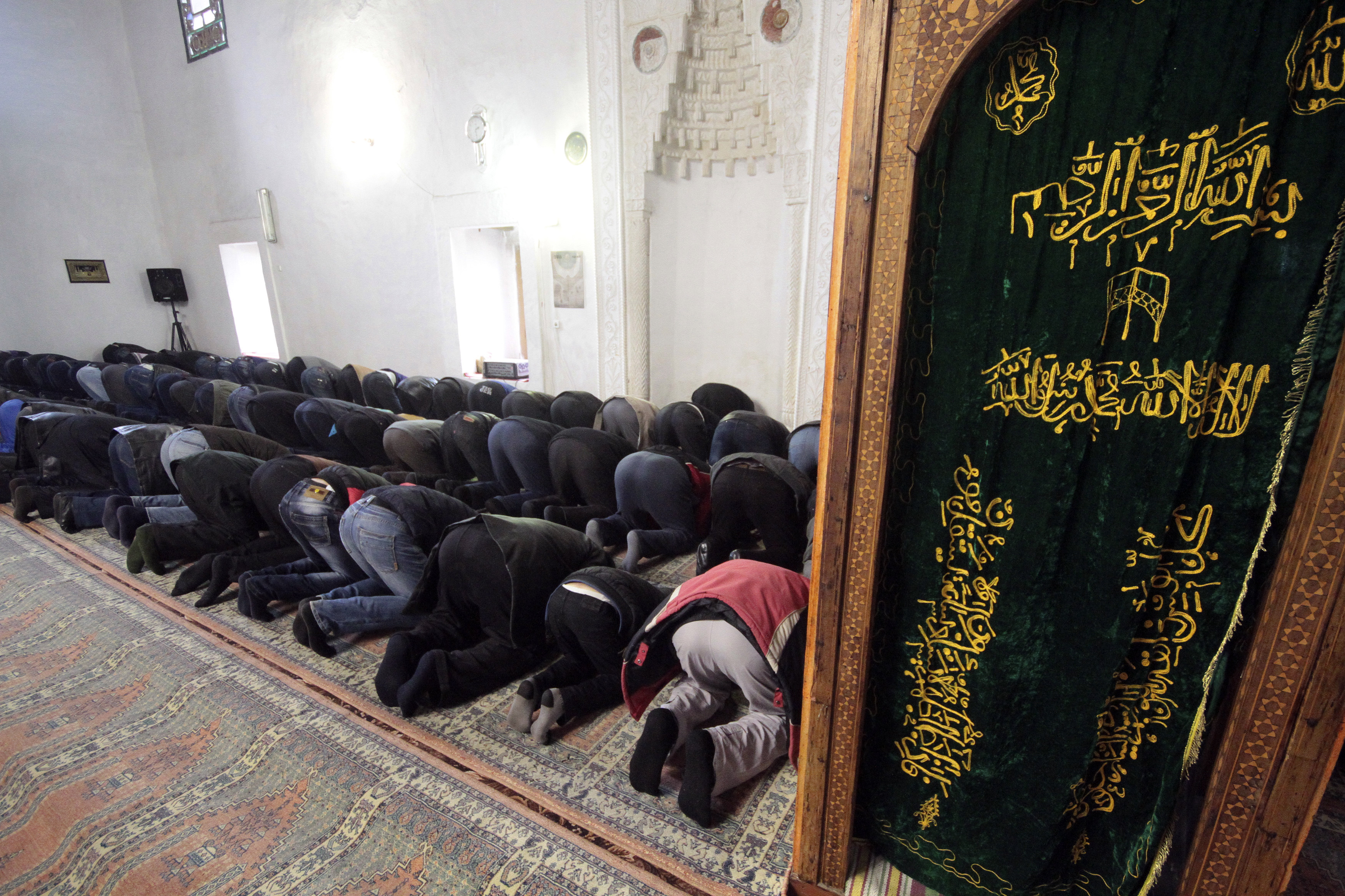 FILE - Muslim Tatar men pray in the Great Khan mosque (Khan Dzhami) in the Crimean town of Bakhchisaray, March 13, 2015.