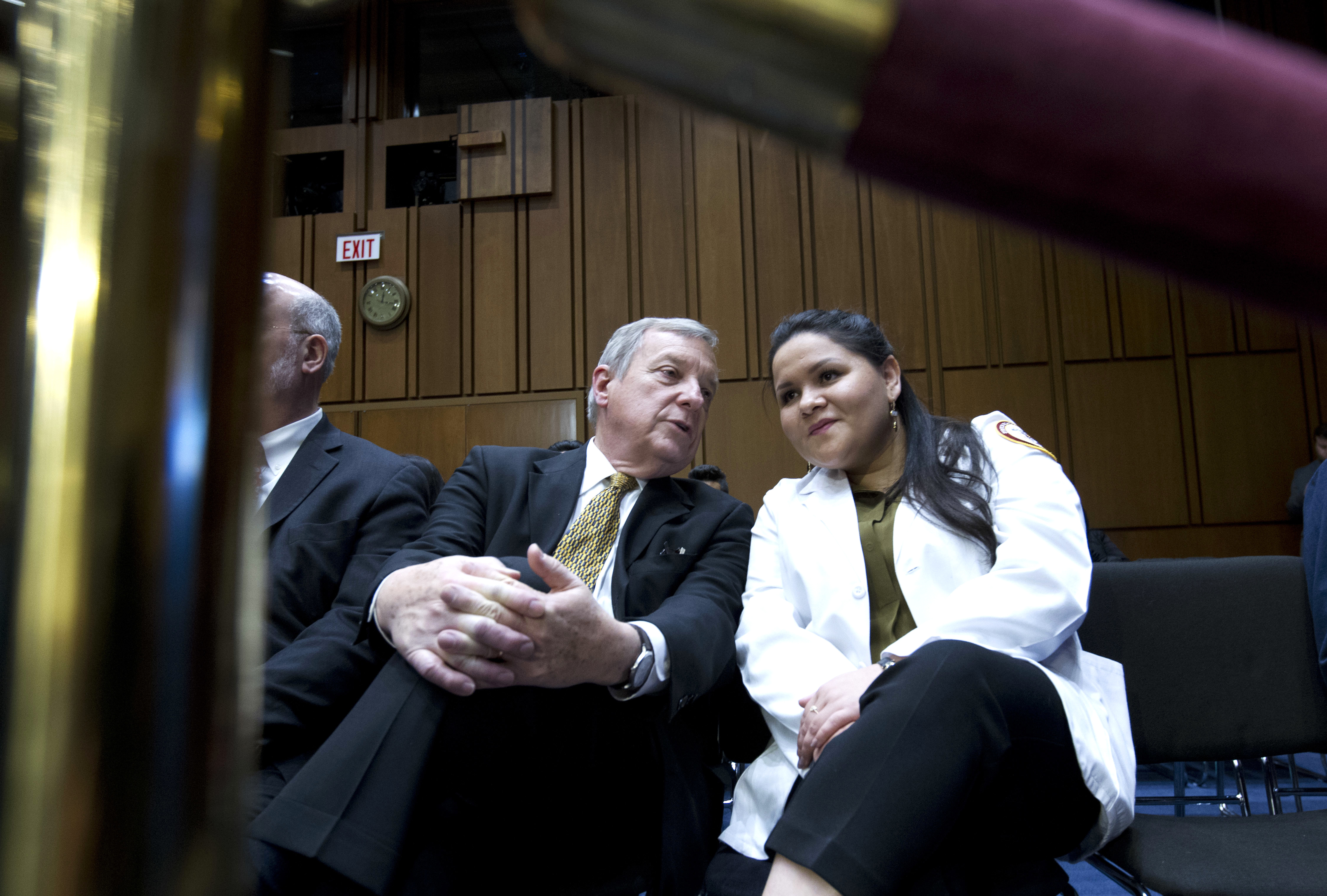 Sen. Dick Durbin D-Ill., speaks with medical student Alejandra Duran from Chicago, during a hearing with Homeland Security Secretary Kirstjen Nielsen on Capitol Hill, Jan. 16, 2018, in Washington.
