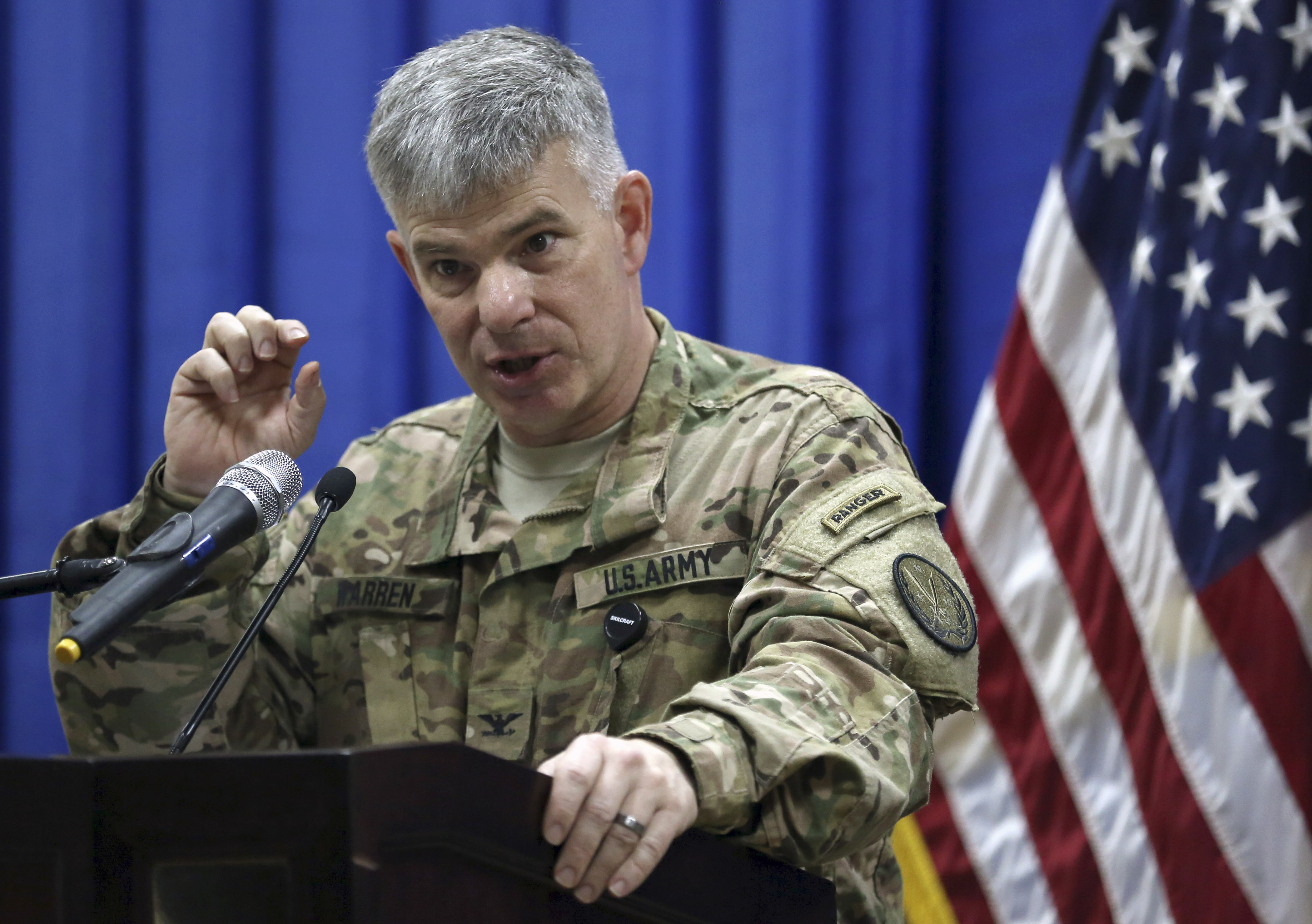 FILE - Col. Steve Warren, the new spokesman for the U.S.-led coalition in Iraq, speaks to reporters during a news conference at the U.S. Embassy in the heavily fortified Green Zone in Baghdad, Iraq.