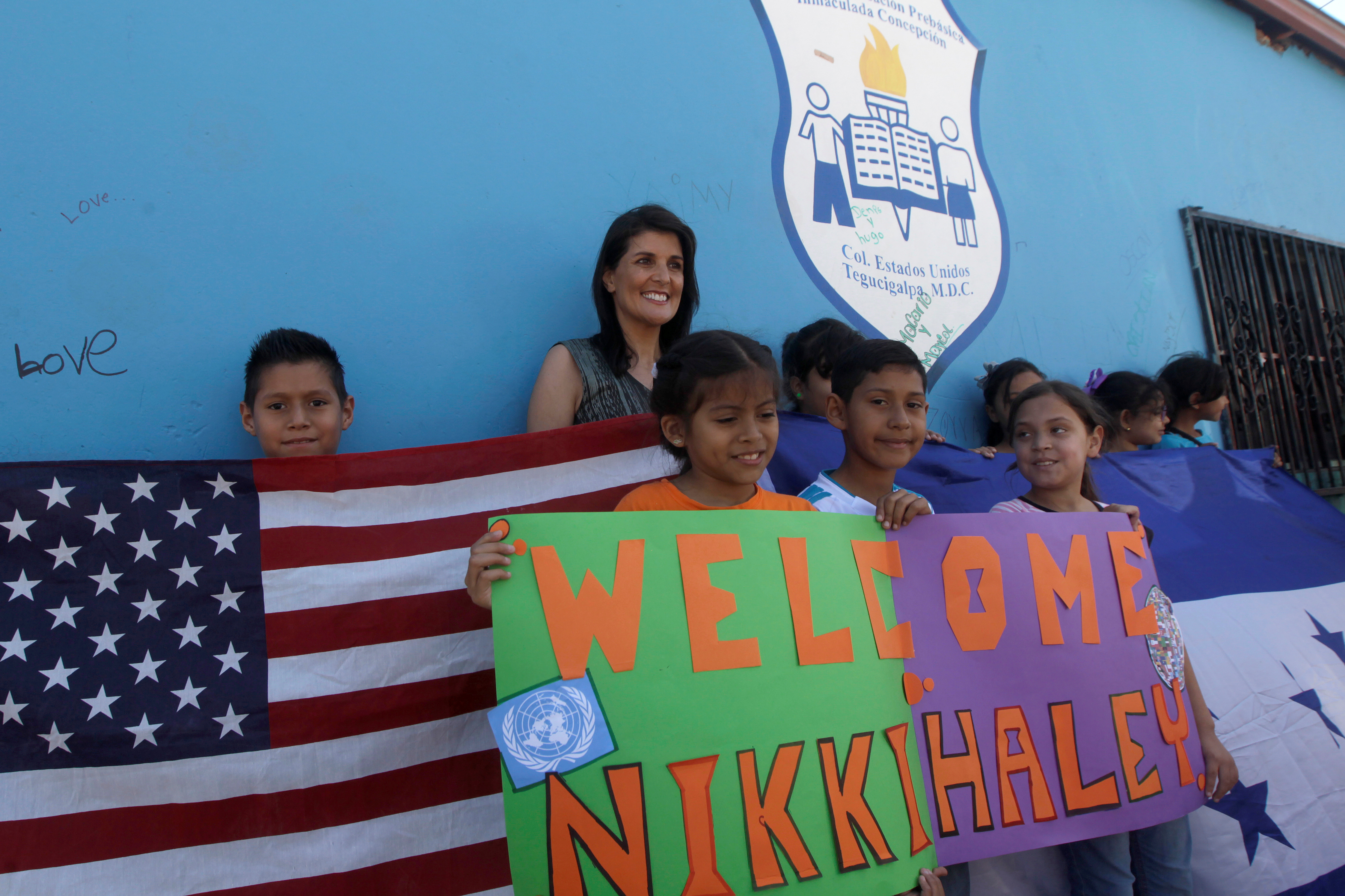 U.S. Ambassador to the United Nations Nikki Haley poses for a picture with children at a school in Tegucigalpa, Honduras Feb. 27, 2018.