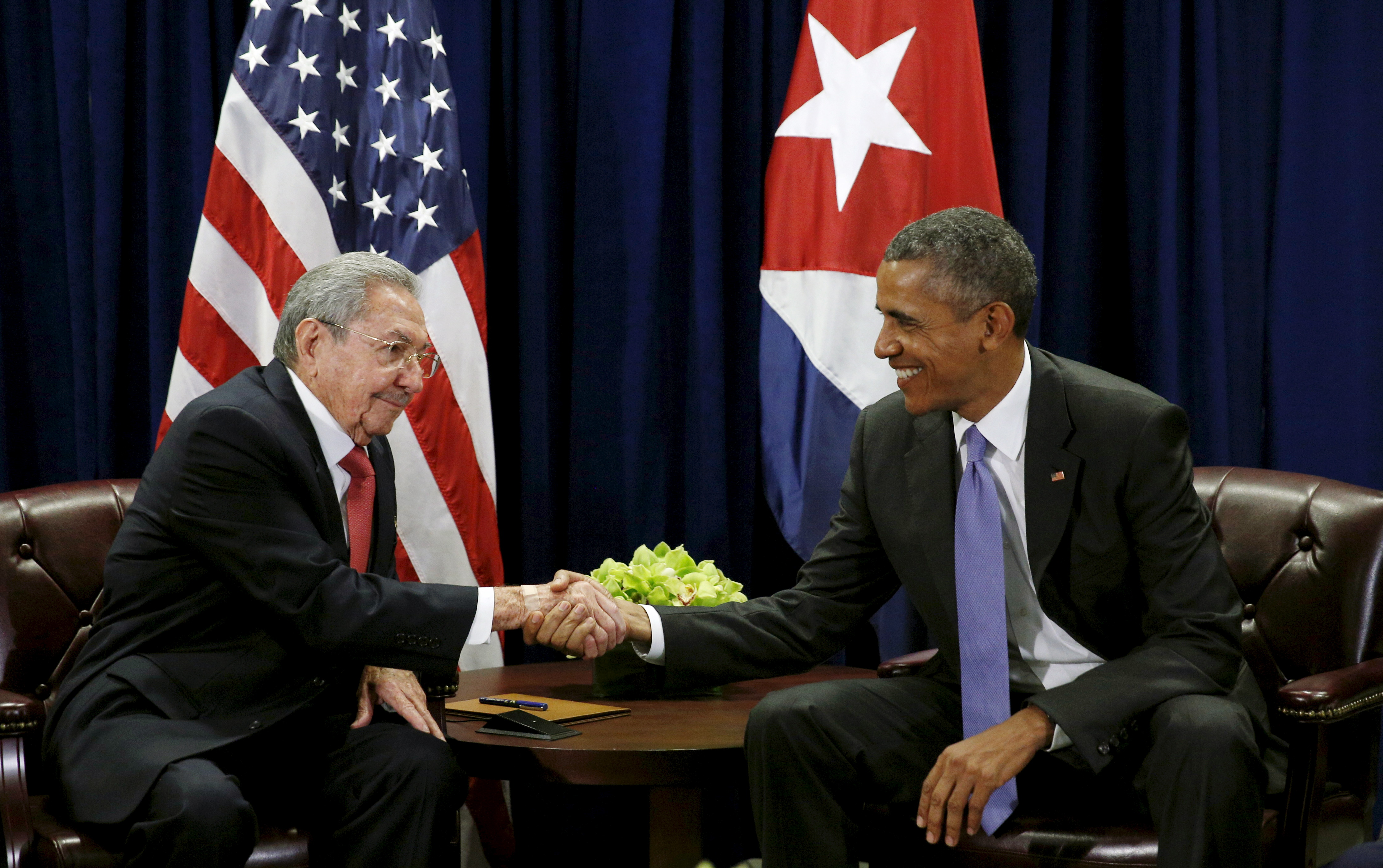 U.S. President Barack Obama (R) and Cuban President Raul Castro shake hands at the start of their meeting at the United Nations General Assembly in New York September 29, 2015.