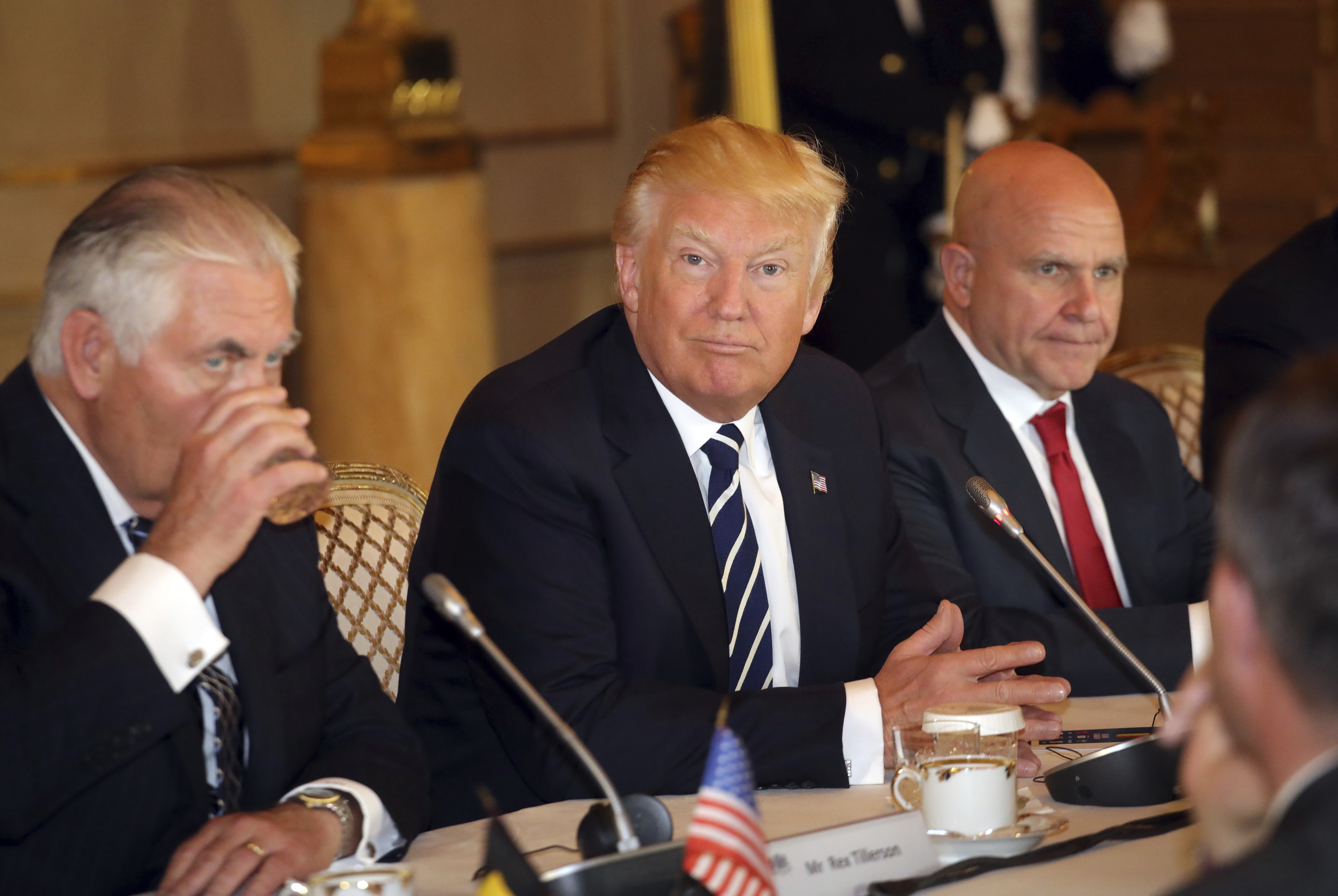 U.S. President Donald Trump, center, sits with then-Secretary of State Rex Tillerson, left, and then-National Security Adviser H.R. McMaster in Brussels, May 24, 2017.