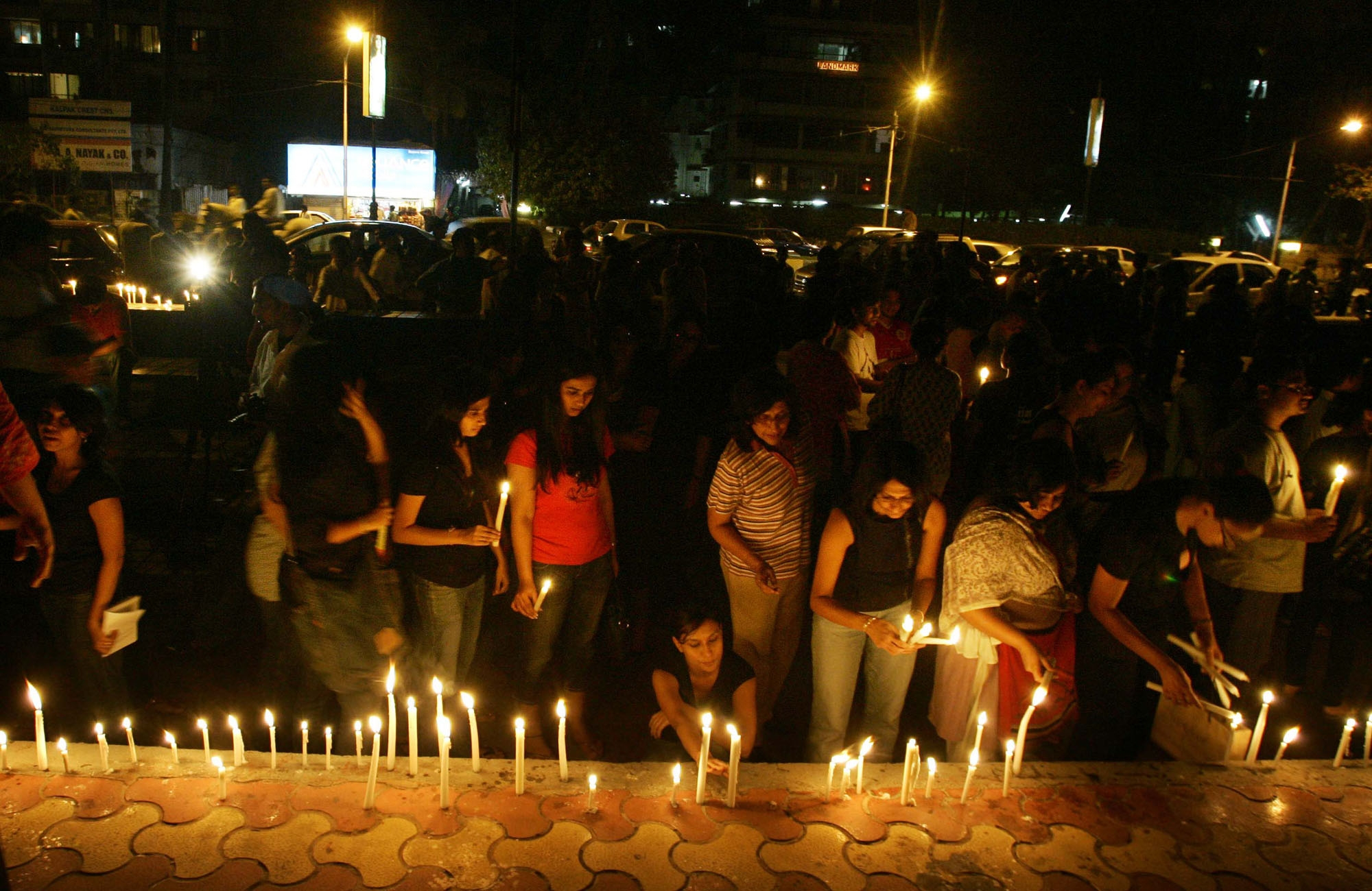 FILE - Members of the public observe a candlelight vigil for the victims of terrorist attacks in which scores were killed, in Mumbai, India, Nov. 29, 2008.