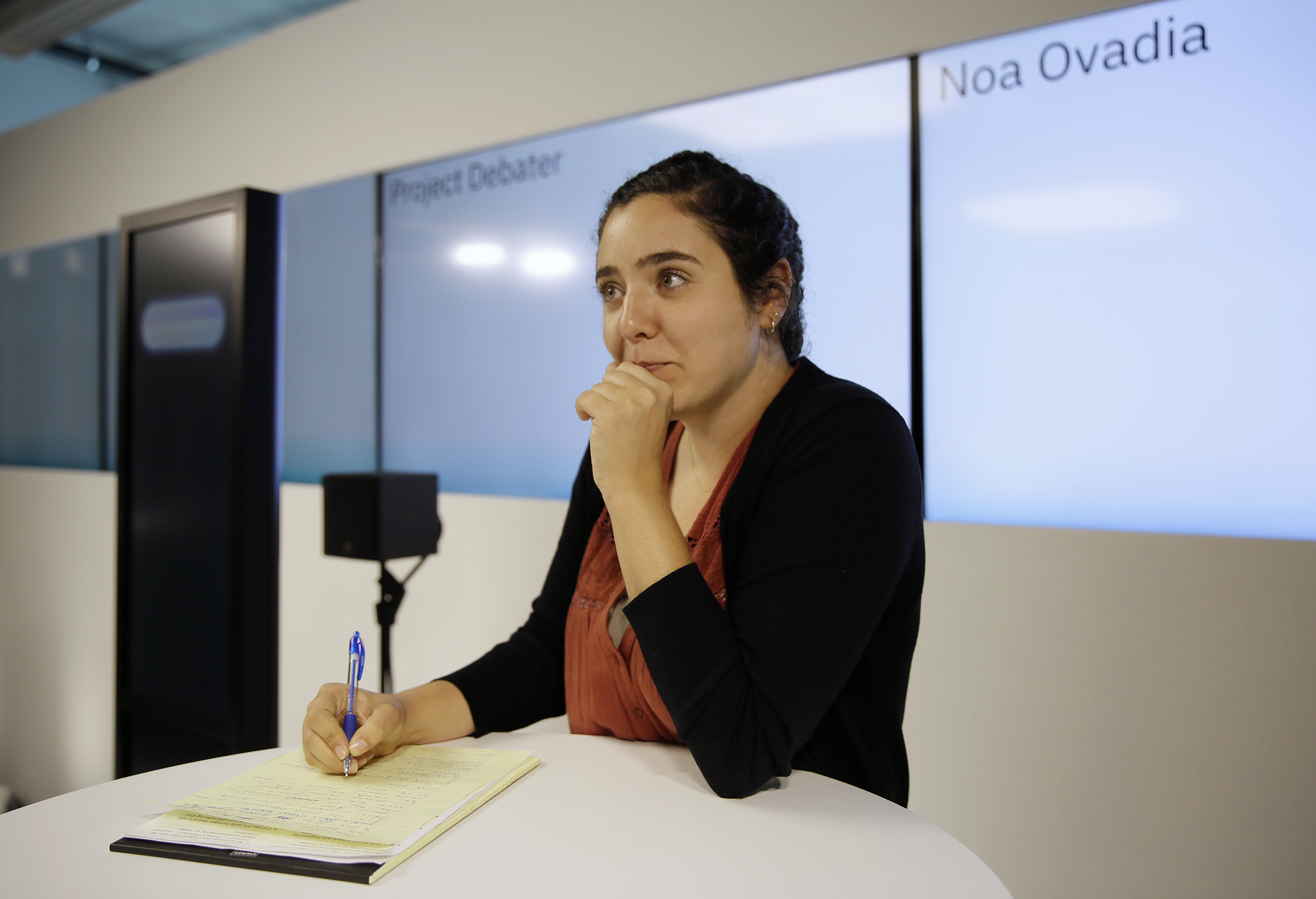Noa Ovadia takes notes during her debate against the IBM Project Debater in San Francisco, June 18, 2018.