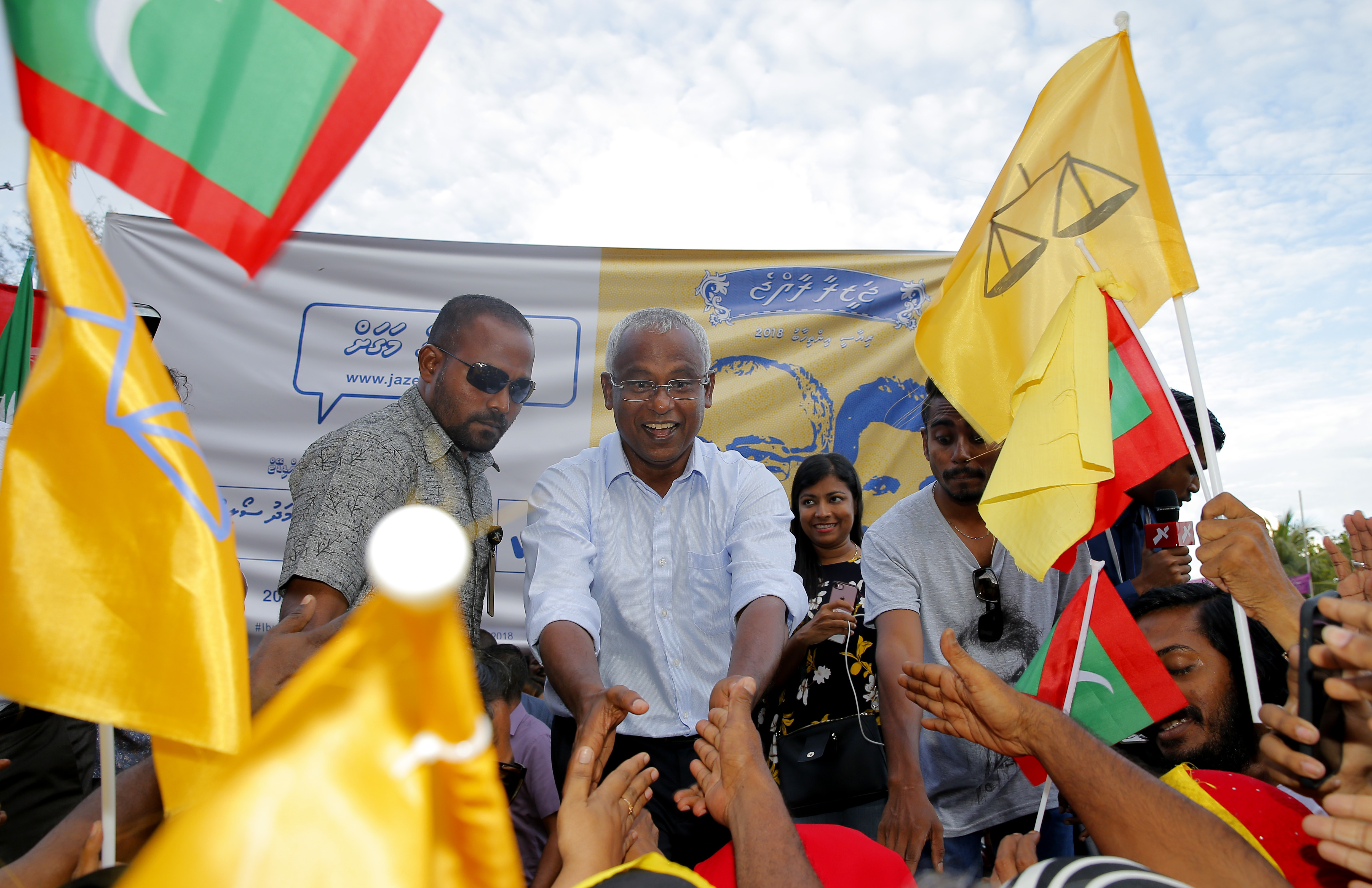 Ibrahim Mohamed Solih (C), the president-elect of the Maldives, interacts with his supporters during a gathering in Male, Maldives, Sept. 24, 2018.