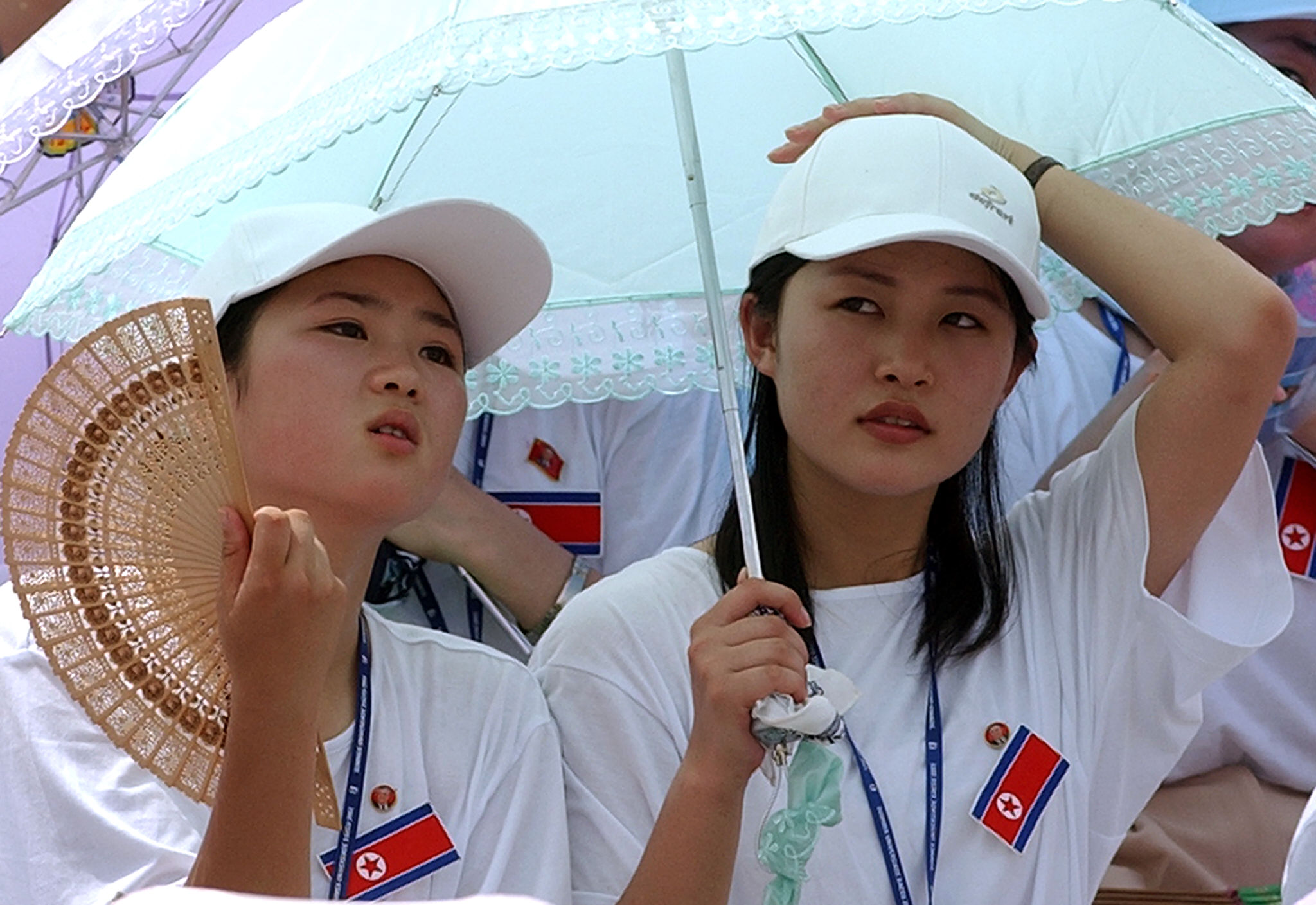 In this 2003 photo, North Korean cheerleaders watch their team play Germany in the women's football match in Gimcheon Stadium.