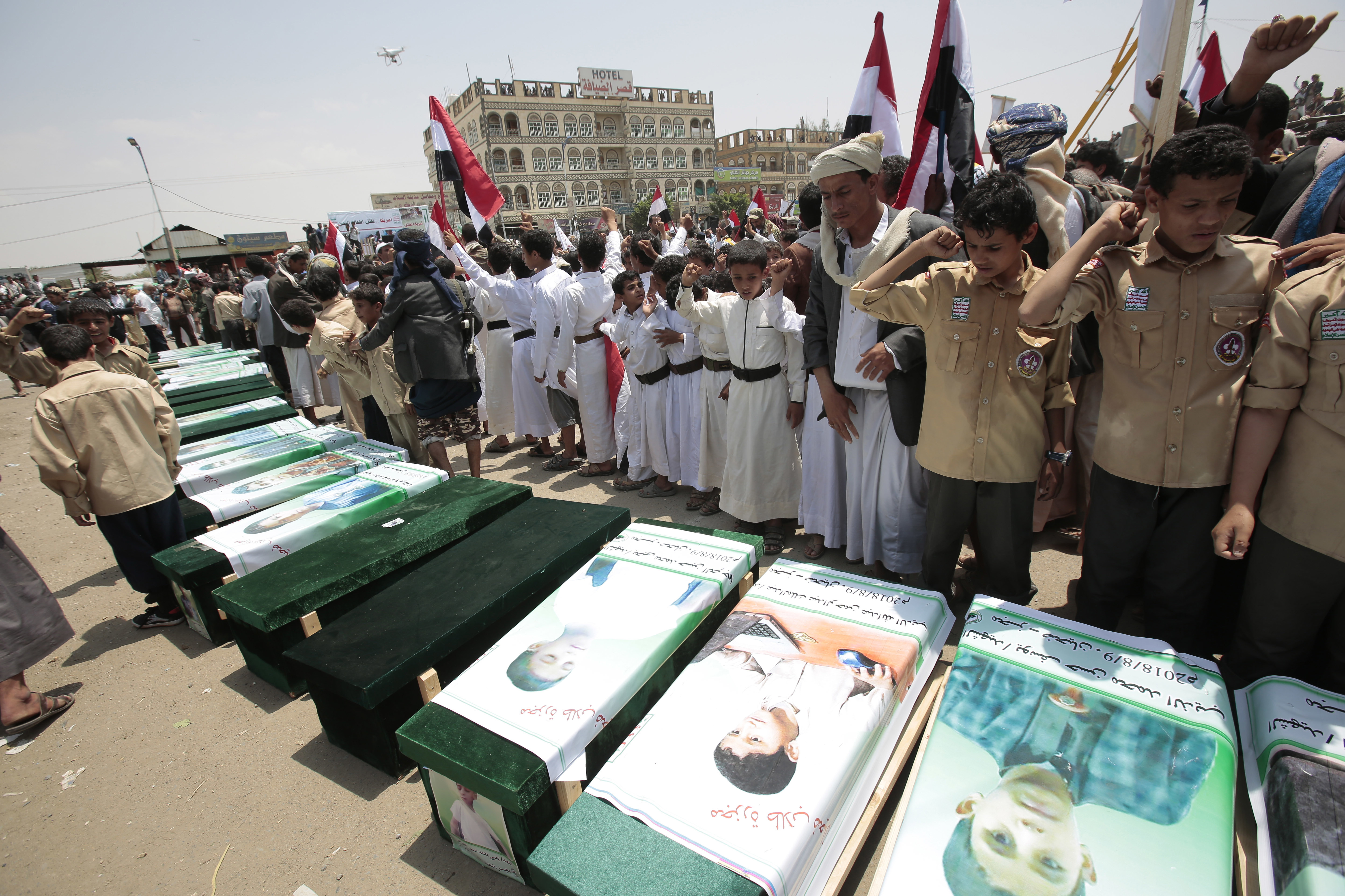 Yemeni people attend the funeral of victims of a Saudi-led airstrike, in Saada, Yemen, Aug. 13, 2018.