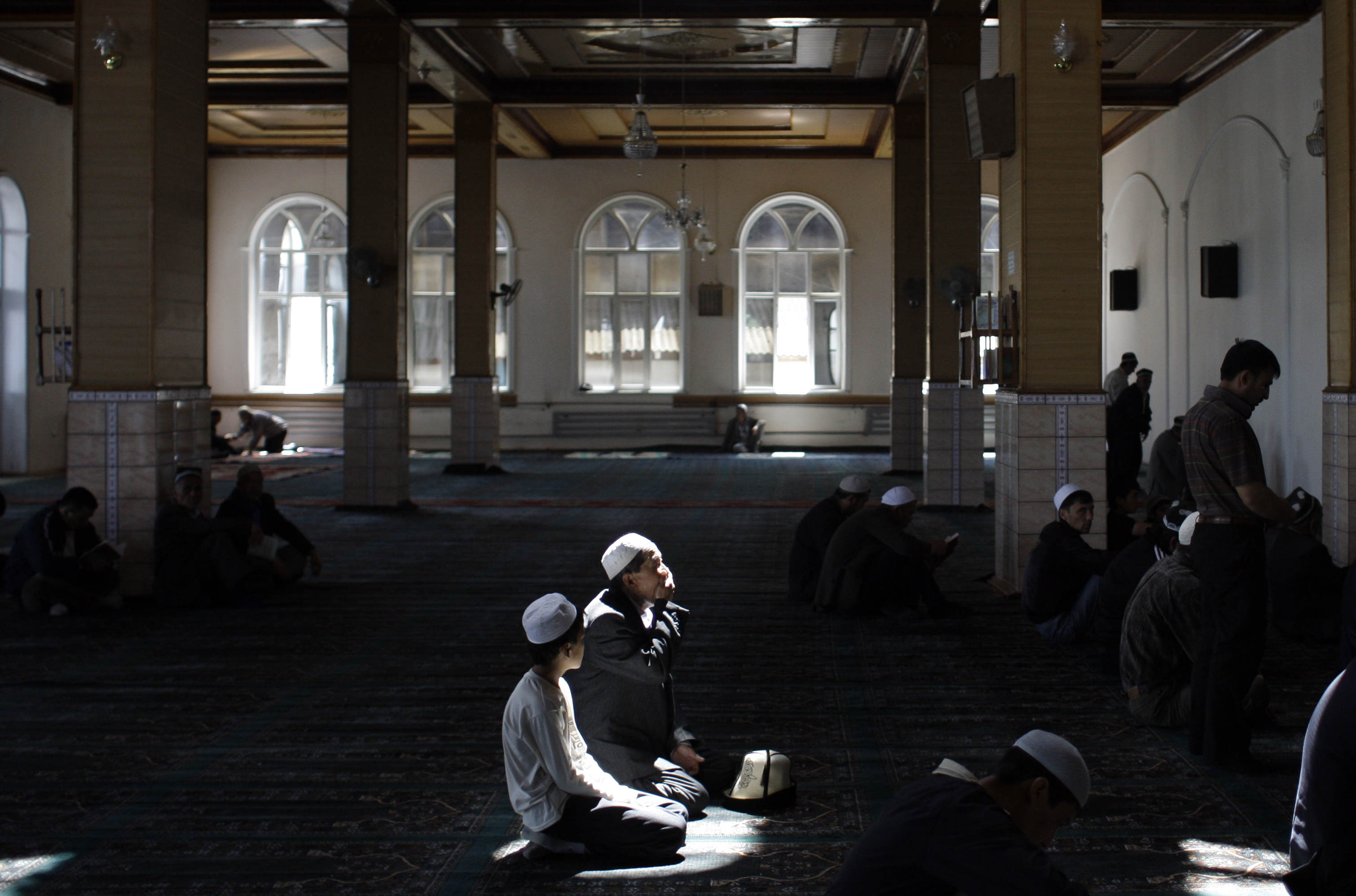 FILE - Kyrgyz men are seen during Friday prayers in a mosque in Osh, southern Kyrgyzstan.