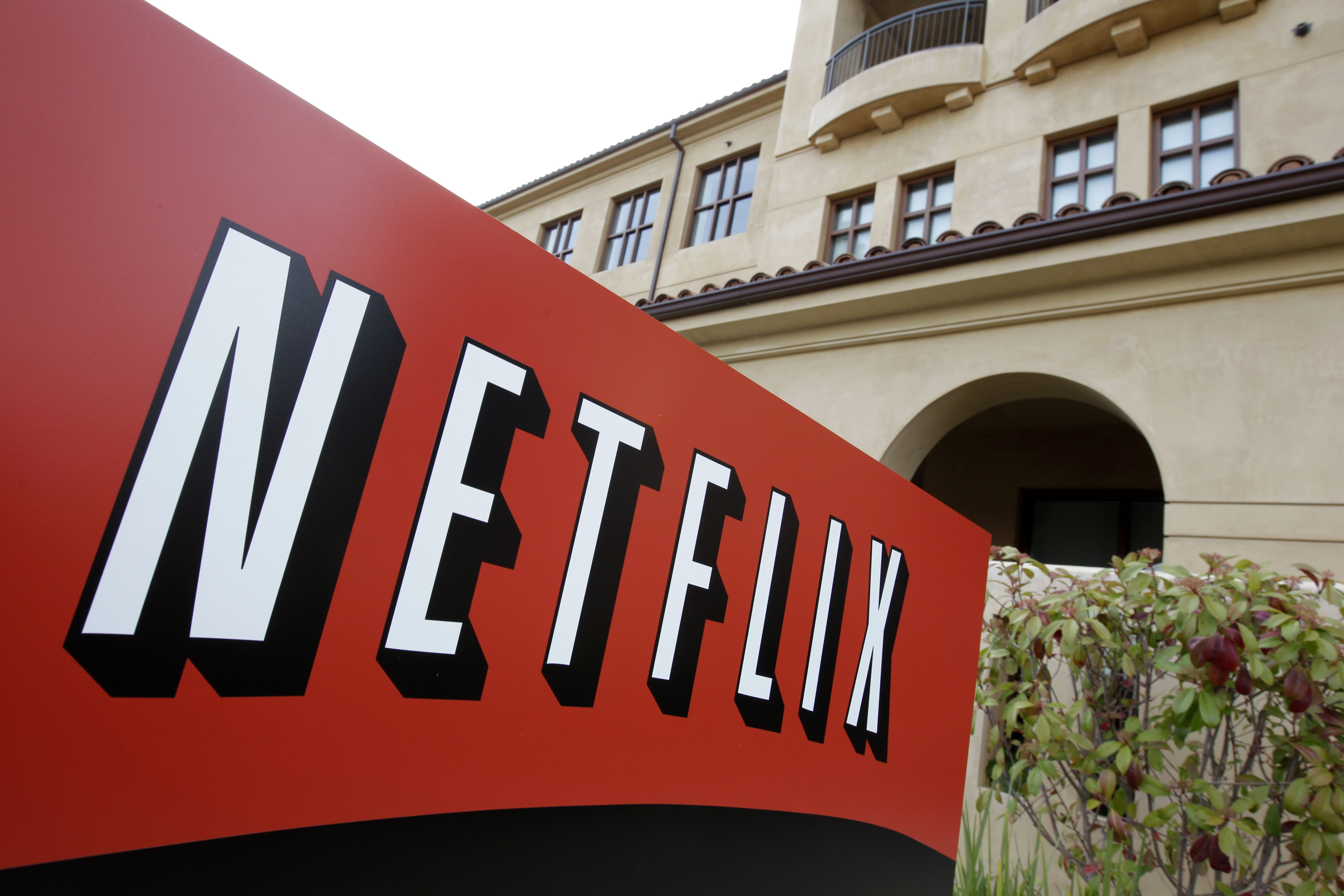 FILE - A sign points to Netfilx headquarters in Los Gatos, Calif. Netflix.