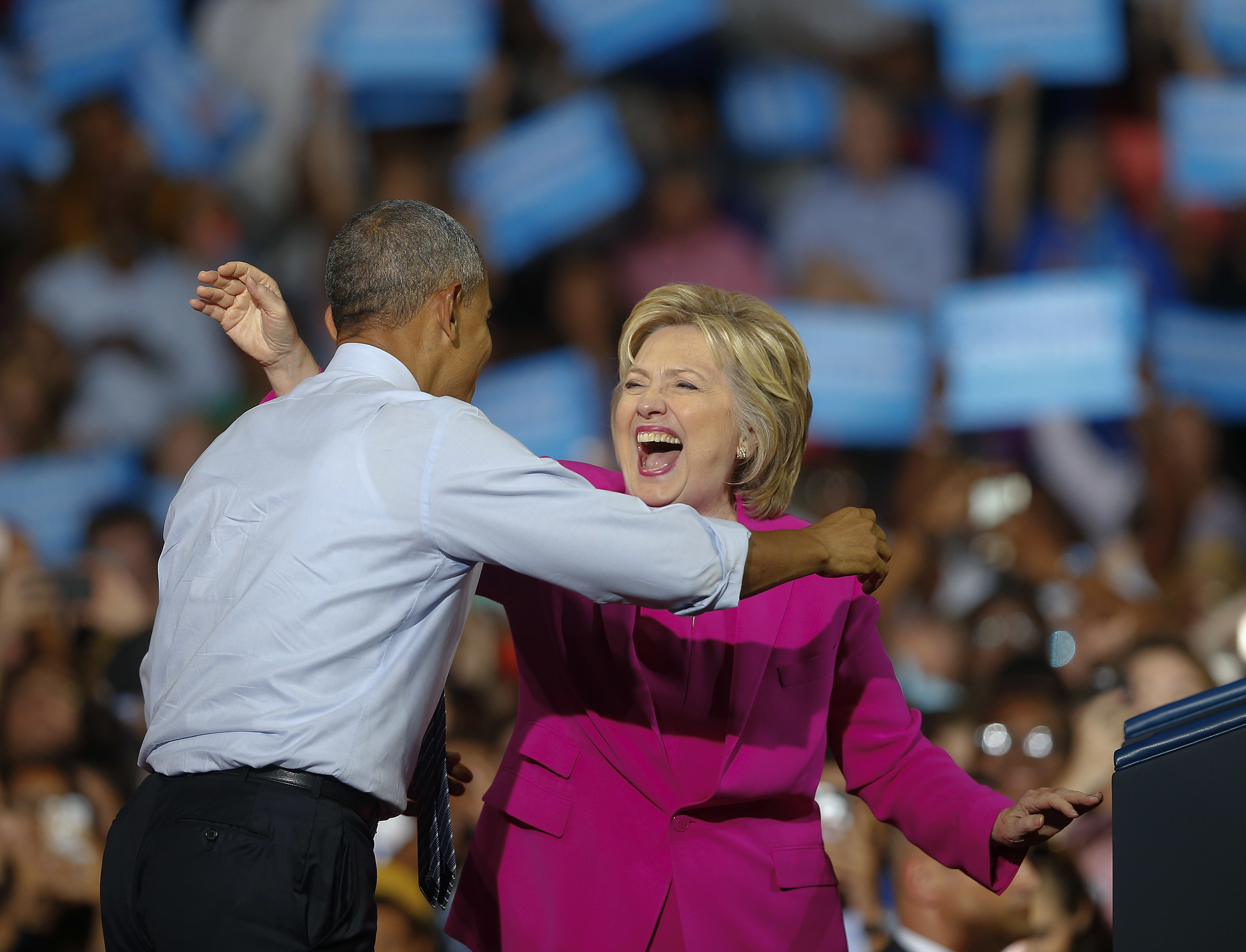 President Barack Obama and Democratic presidential candidate Hillary Clinton embrace during a campaign rally, July 5, 2016, in Charlotte, N.C..