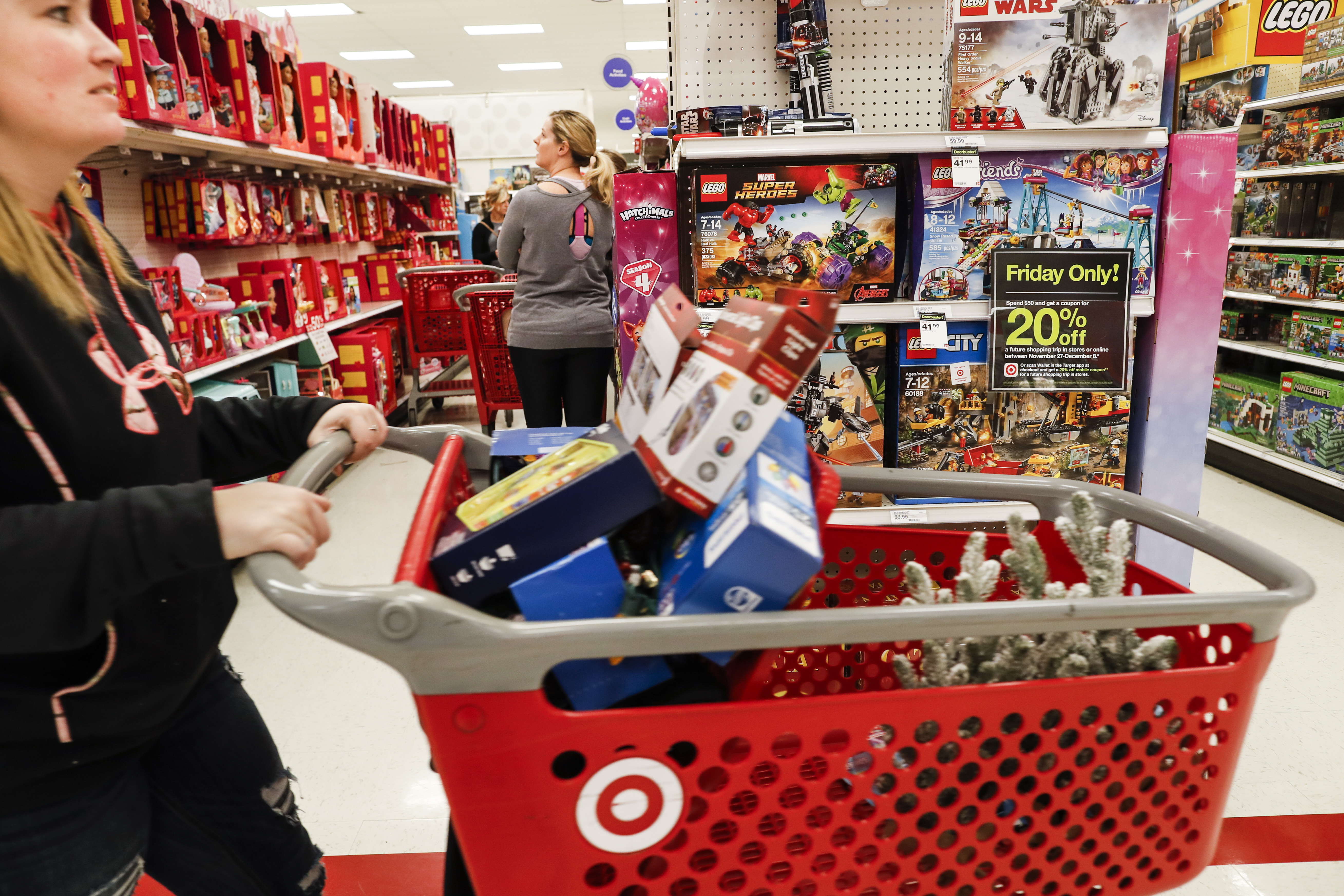 Shoppers browse the aisles during a Black Friday sale at a Target store, Nov. 23, 2018, in Newport, Ky.