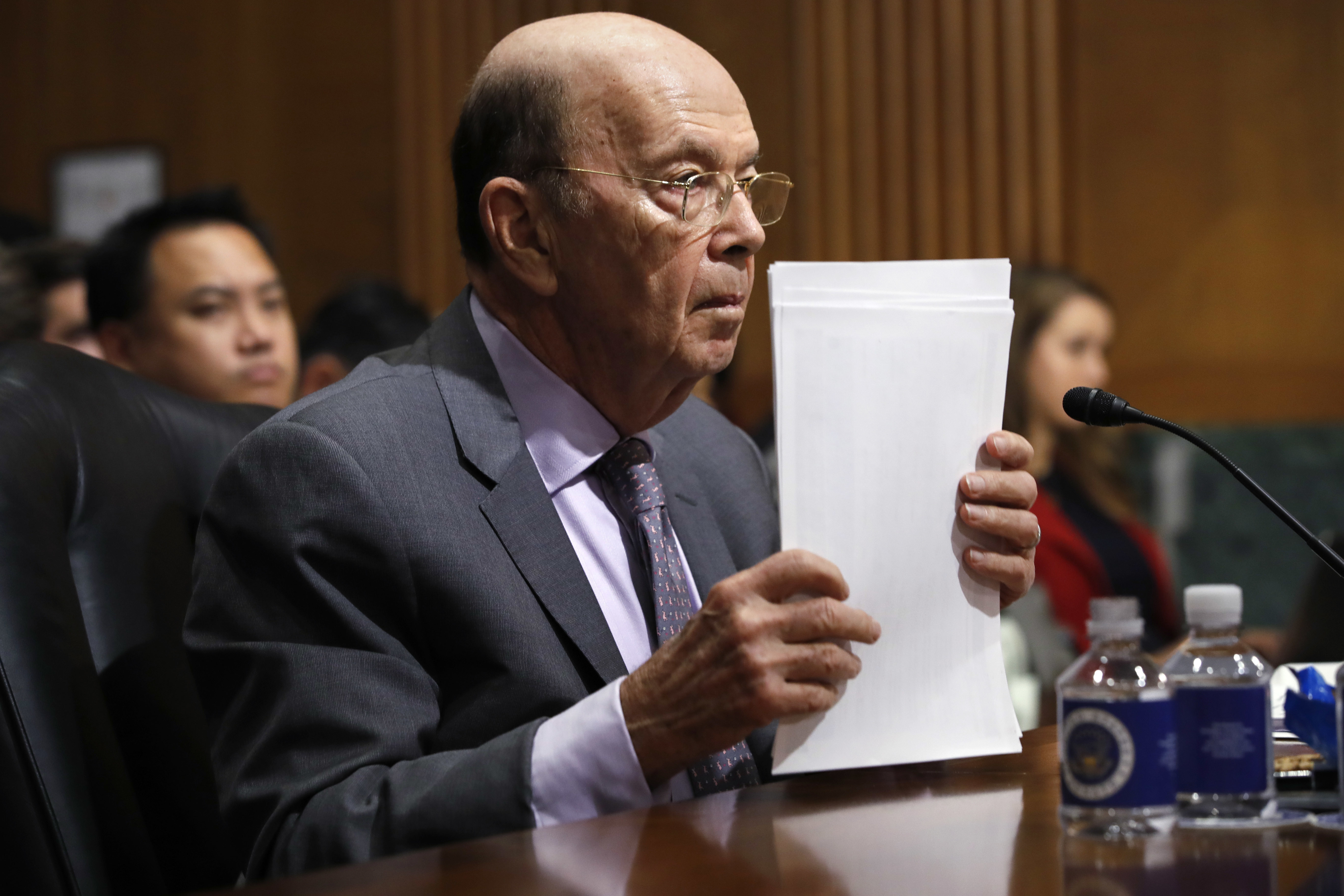 Secretary of Commerce Wilbur Ross straightens his papers during a Senate Finance Committee hearing on tariffs, on Capitol Hill, June 20, 2018 in Washington.