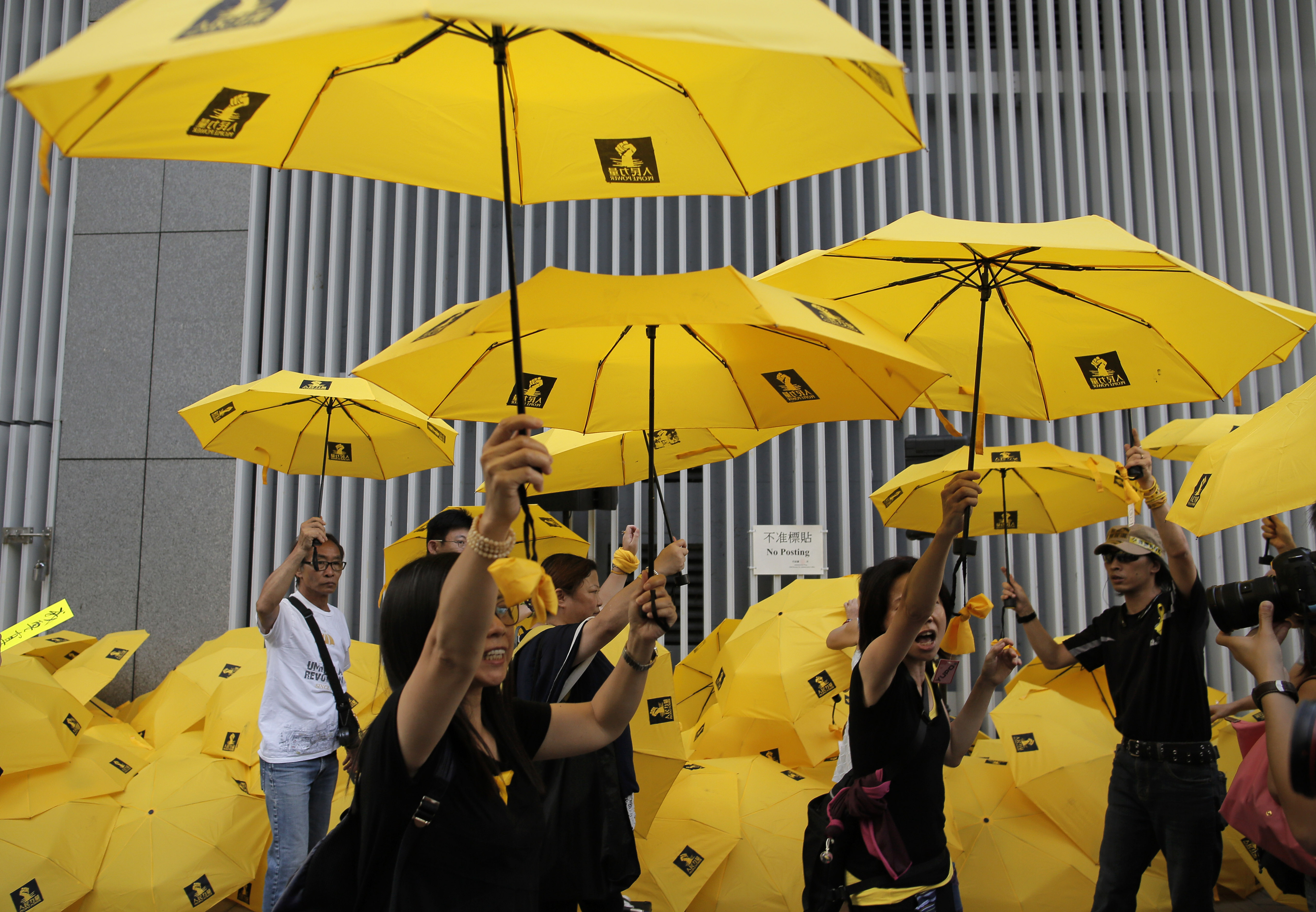 Hong Kong Democracy Activists Get Up to 16 Months in ...