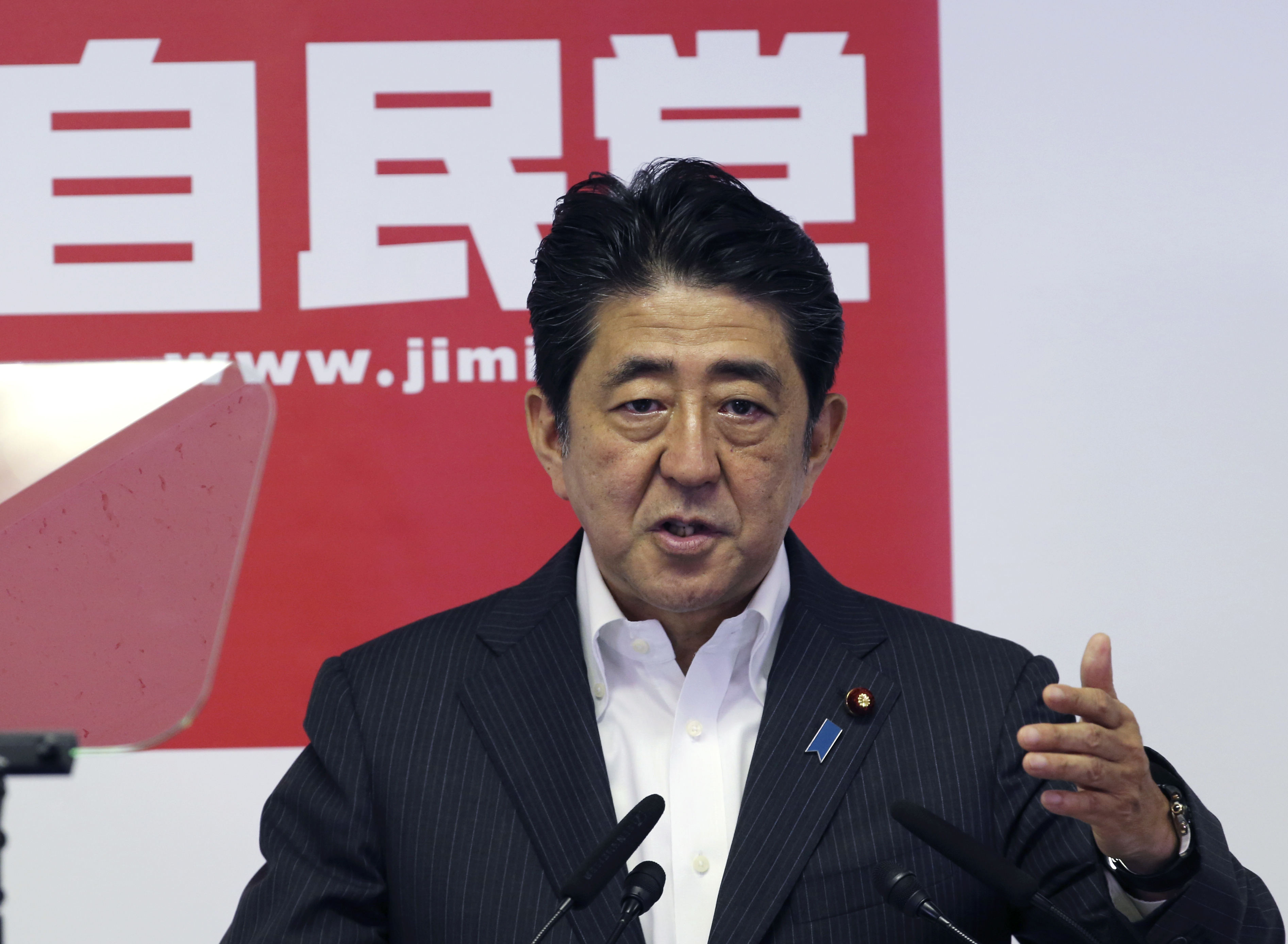 Japanese Prime Minister and leader of the ruling Liberal Democratic Party, Shinzo Abe, speaks during a press conference in Tokyo on July 11, 2016.