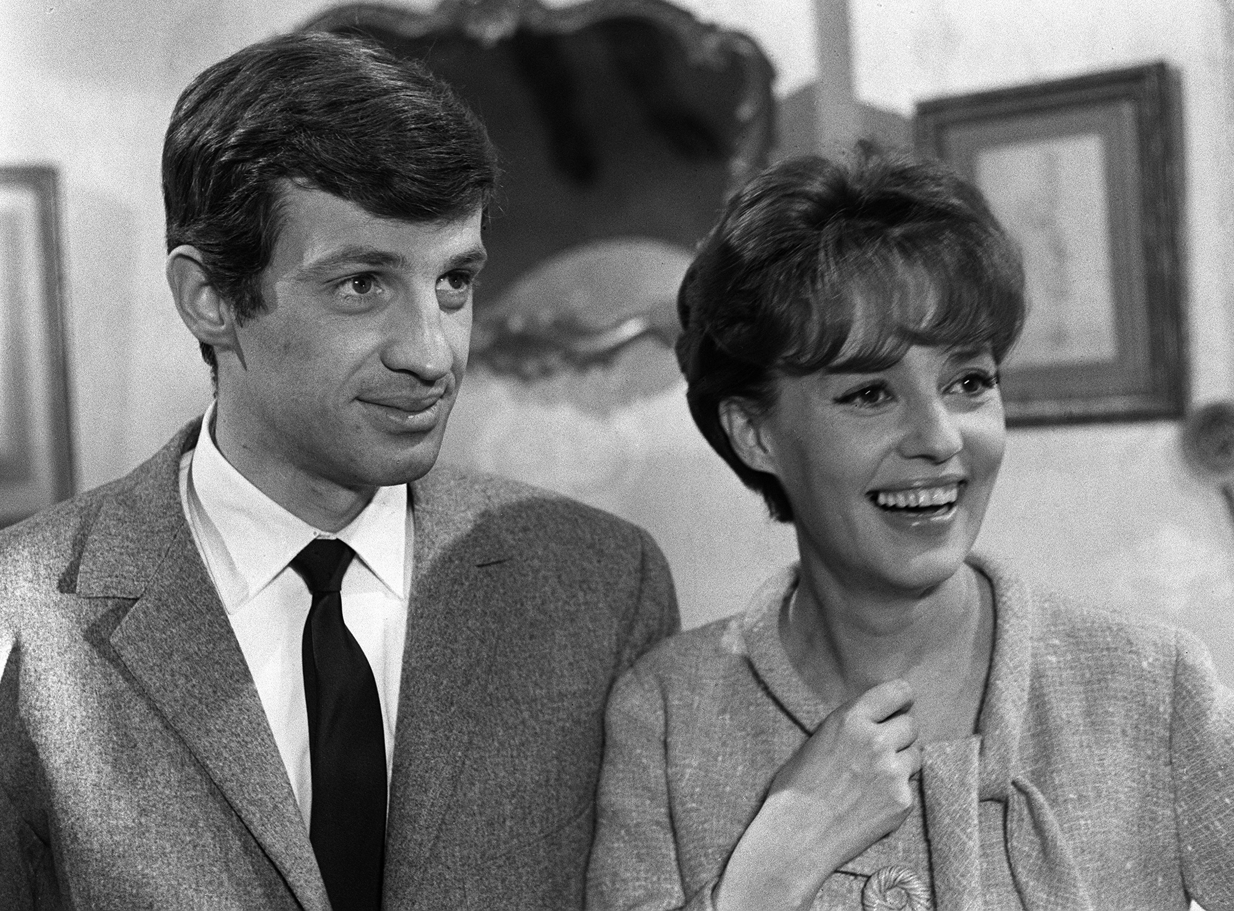 FILE - French actor Jean-Paul Belmondo (L) speaks with actress Jeanne Moreau in Paris, Jan. 1, 1963.