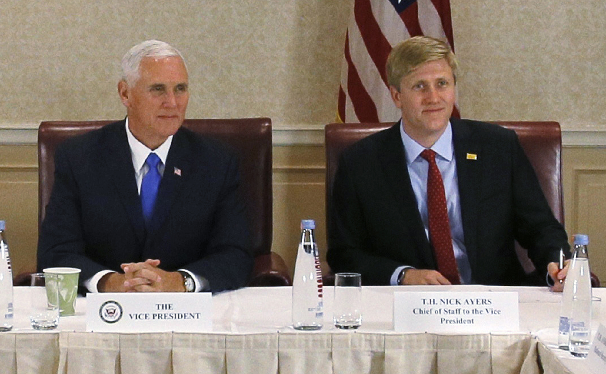 FILE - Vice President Mike Pence, left, attends a meeting with Georgia opposition leaders in Tbilisi, Georgia. Chief of Staff to the Vice President, Nick Ayers, is right.