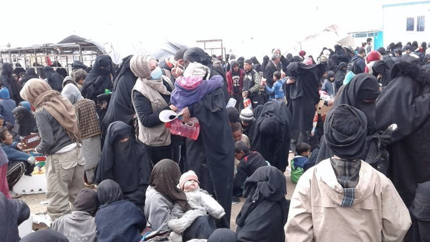 Women and children arrive at a reception area at al-Hol camp in northeast Syria, March 14, 2019. (Photo courtesy of International Rescue Committee)