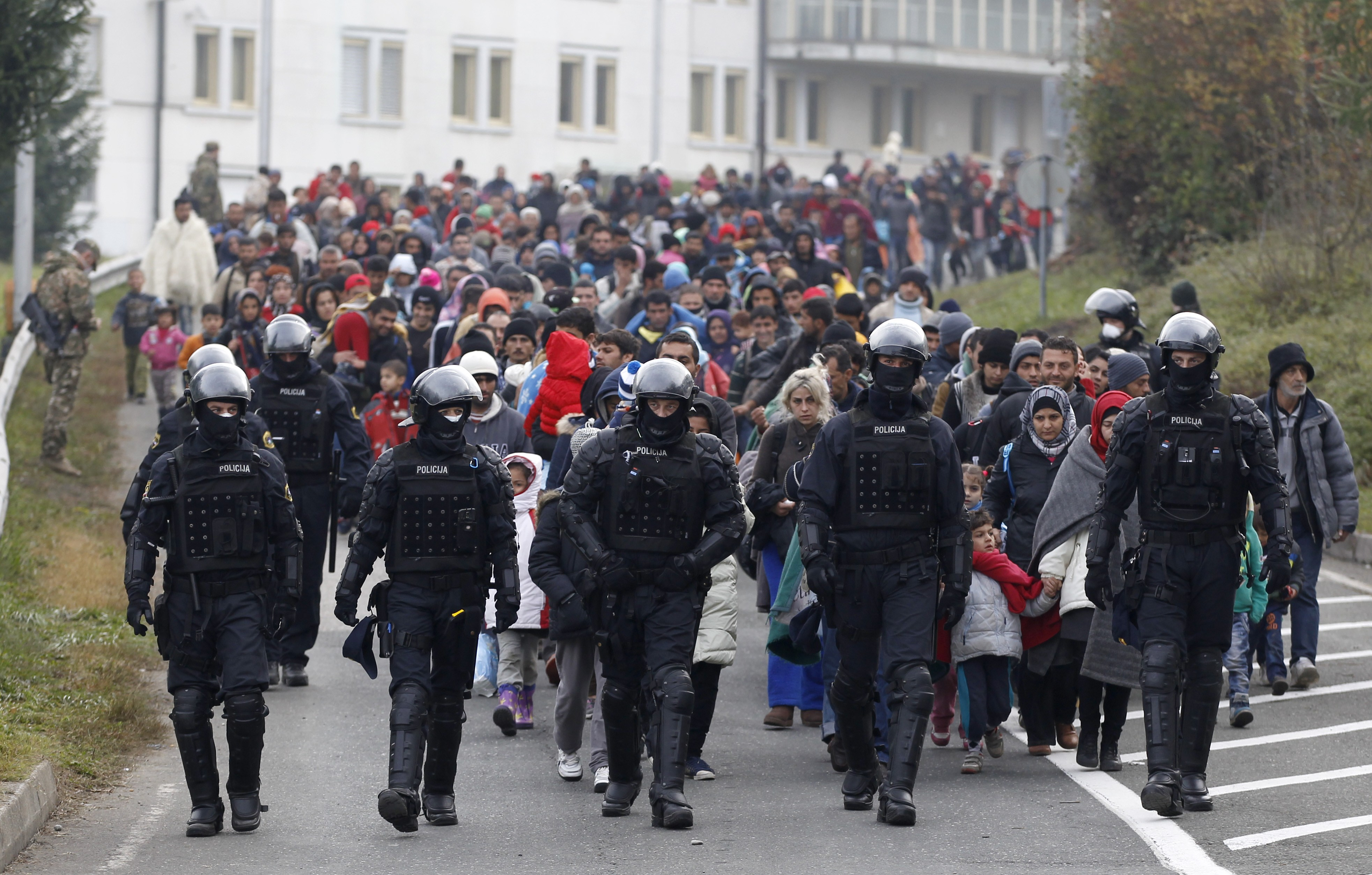 A group of migrants walks toward Austria from a camp in Sentilj, Slovenia, Oct. 25, 2015. Thousands are trying to reach central and northern Europe via the Balkans but often have to wait for days in mud and rain at the Serbian, Croatian and Slovenian...