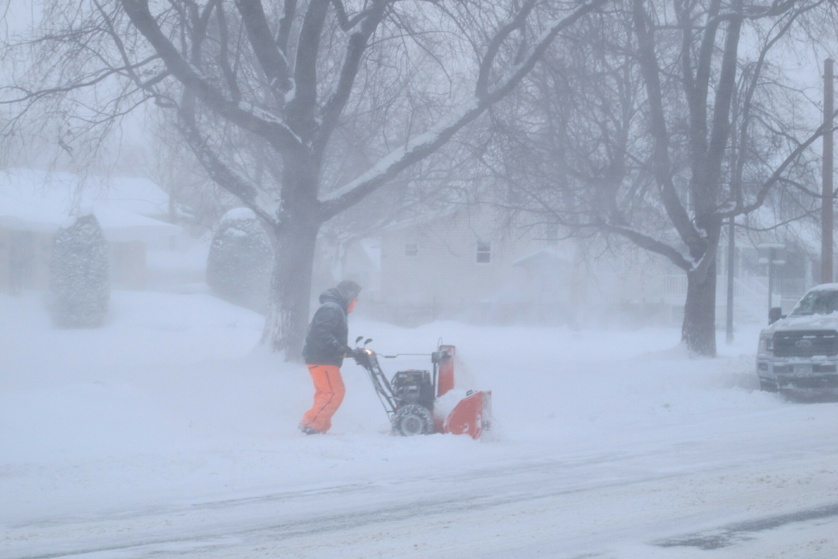 A man is bundled up against bitter wind and blowing snow as he operates a snowblower, Jan. 30, 2019, in Buffalo, N.Y. The area received more than a foot of snow since Tuesday and was under a blizzard warning.