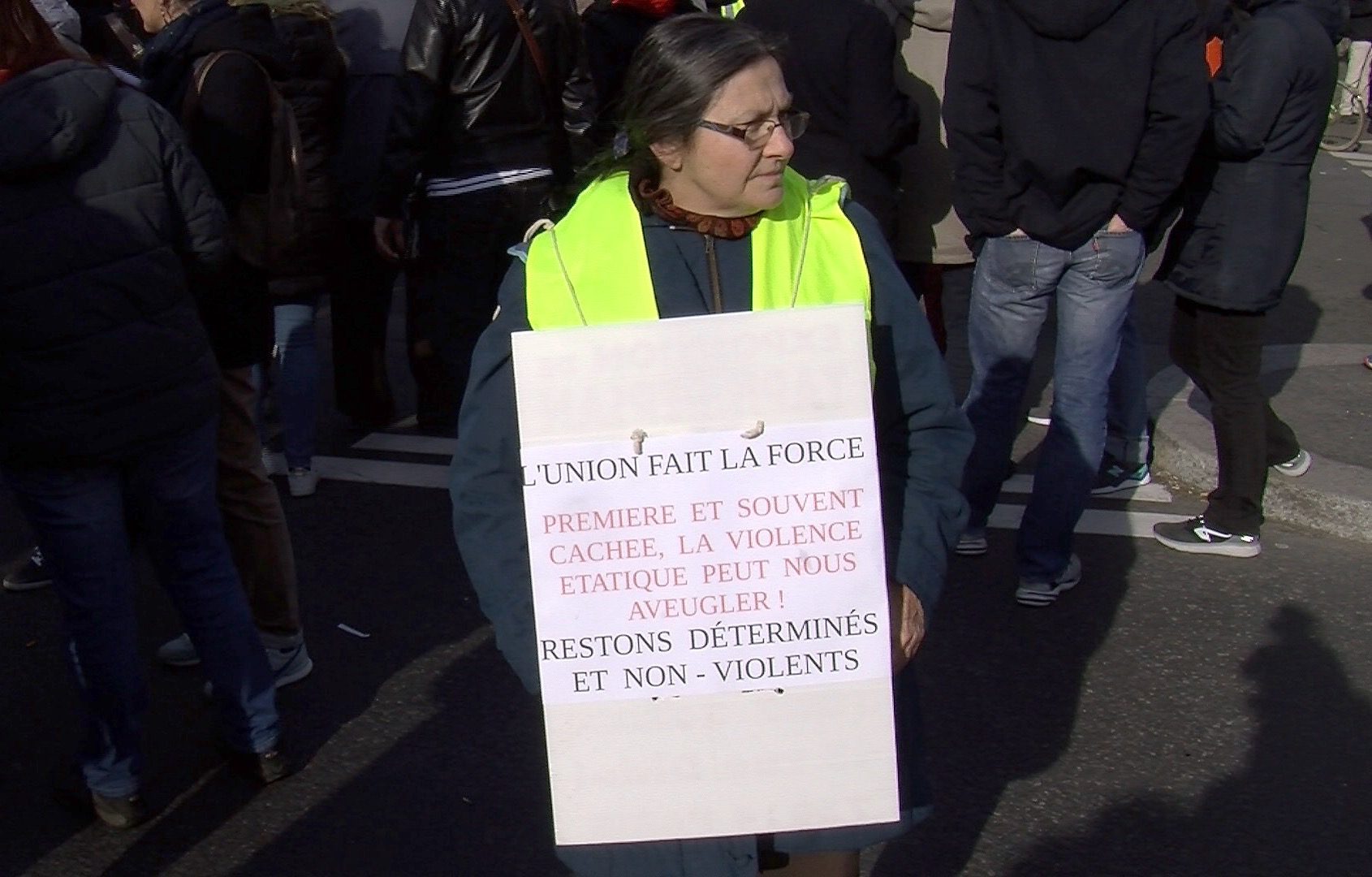 A yellow vest protester calls for less violence but for demonstrations to continue.