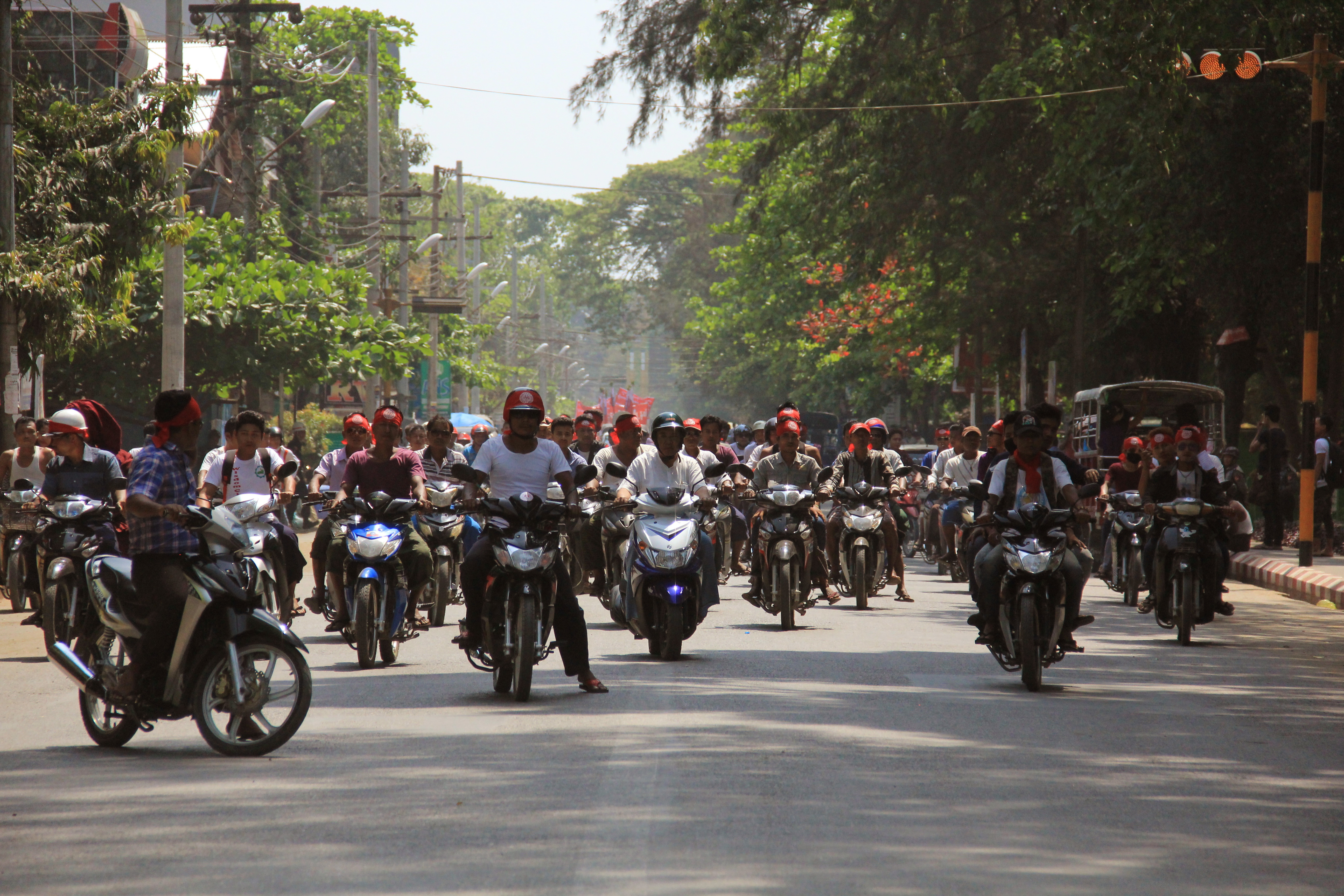 Hard-line Buddhists ride on motorbikes during a protest march, led by Rakhine State's dominant Arakan National Party, against the government's plan to give citizenship to some members of the persecuted Rohingya Muslim minority community in Sittwe, Ra...
