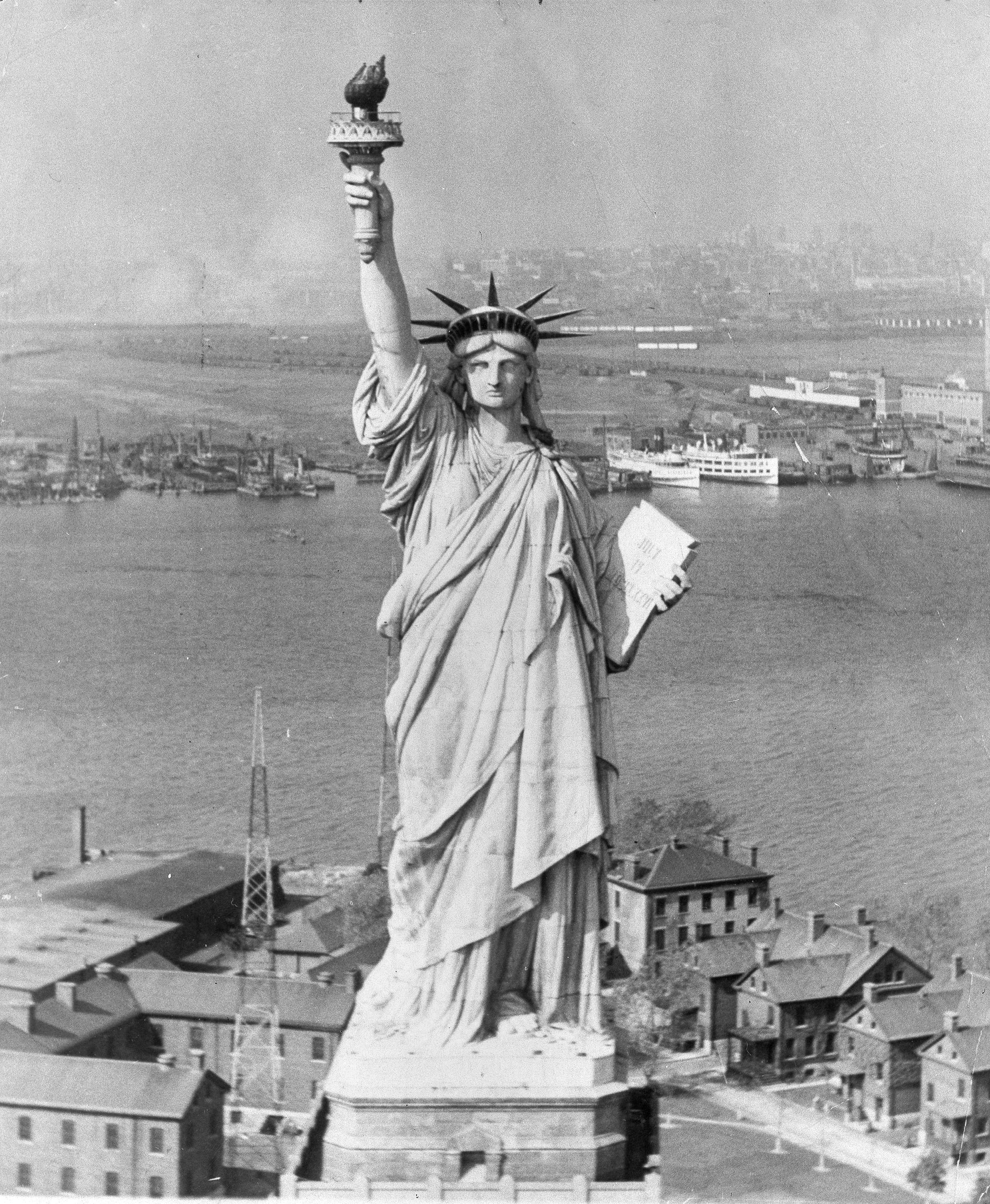 The Statue of Liberty in New York Harbor with New Jersey in the background, Oct. 12, 1933.