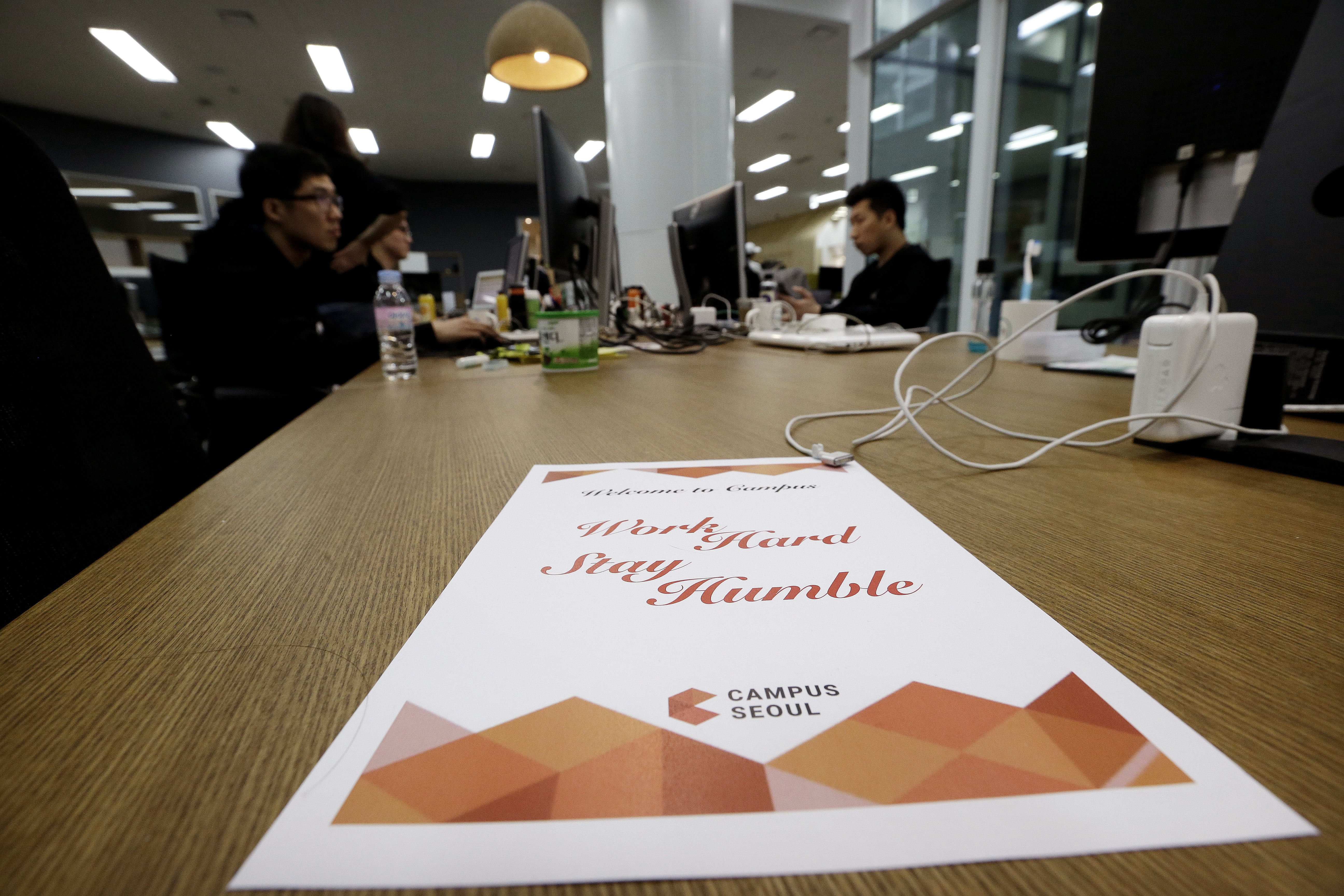 FILE - Employees of Chatting Cat company, a startup and ventures investors, work during a media tour at the Google campus in Seoul, South Korea, May 8, 2015. Seoul is the site of Google's first campus for startups and entrepreneurs in Asia.