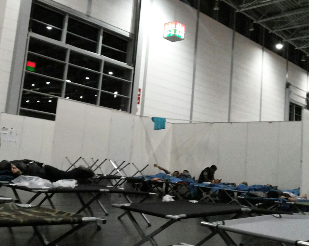 The German government has provided cots and space for refugees as thousands pour in.  Refugees now in Germany say they fear the crowds coming in will make it impossible to sustain livable conditions. Courtesy photo from refugee in Germany, Sept. 19, ...
