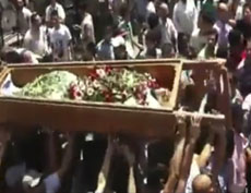 Mourners carry the body of a person during a funeral ceremony in the city of Homs, Syria, in this image made from amateur video released by Ugarit News, August 2, 2011