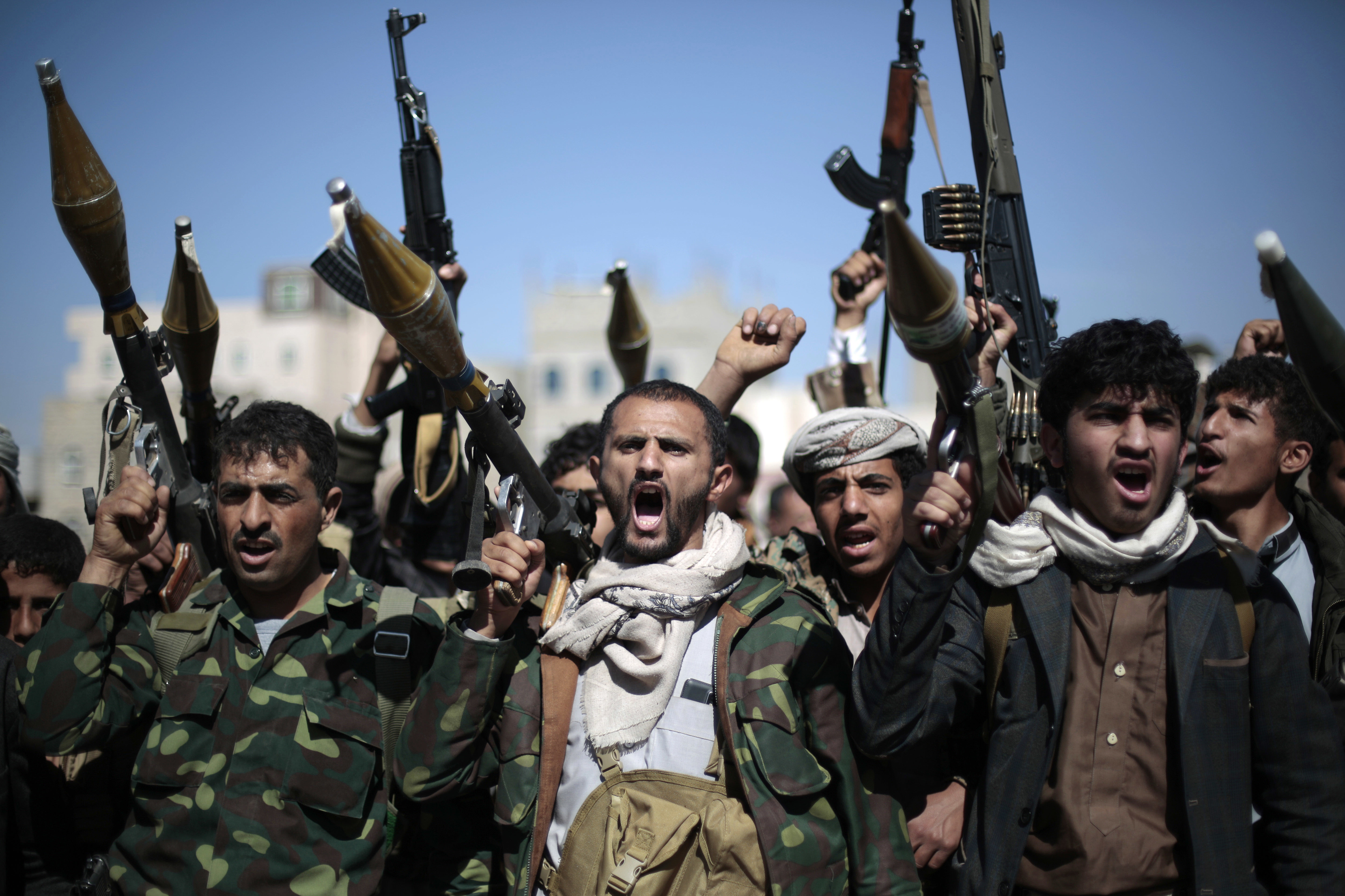 FILE - In this Nov. 24, 2016, photo, tribesmen loyal to Houthi rebels hold their weapons as they chant slogans during a gathering to mobilize more fighters into battlefronts in several Yemeni cities, in Sanaa, Yemen.
