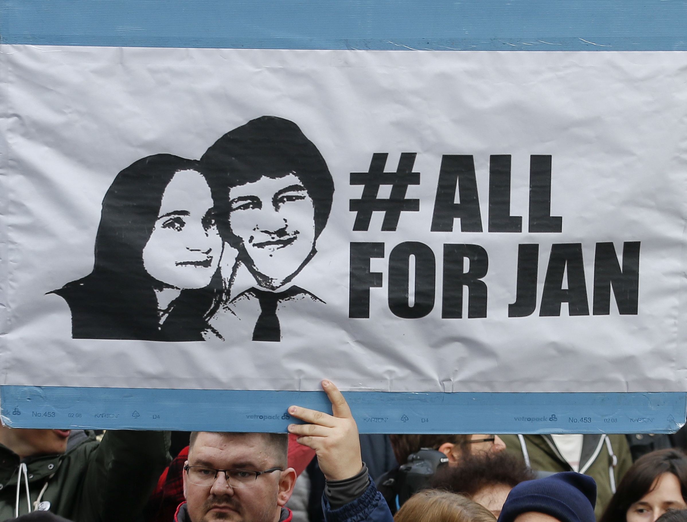 FILE- In this file photo taken on March 16, 2018, people celebrate the resignation of Prime Minister Robert Fico as a way out of the political crisis triggered by the slayings of journalist Jan Kuciak, during a rally in Bratislava, Slovakia.