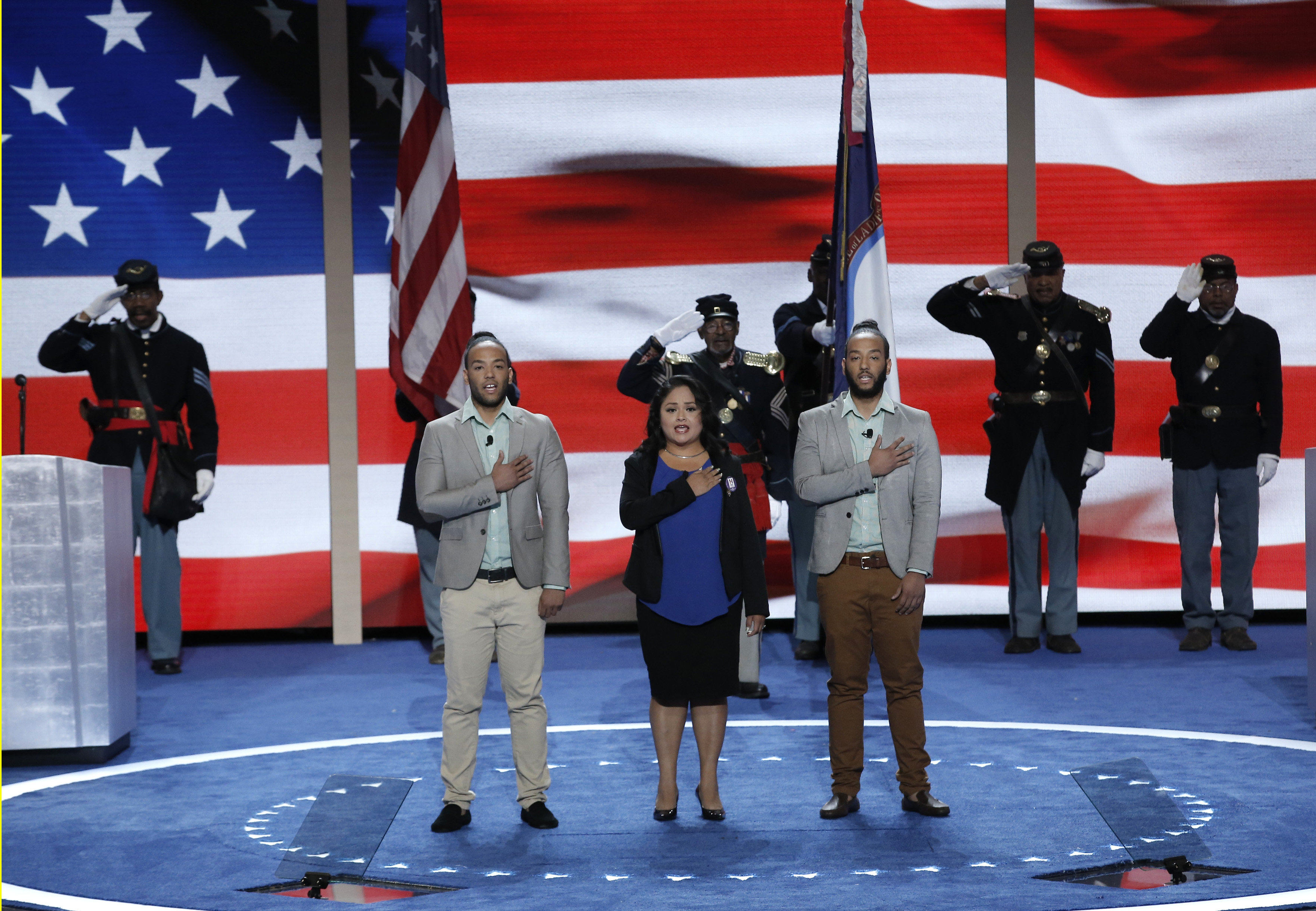 Newly naturalized U.S. citizens lead the U.S. Pledge of Allegiance at the start of the final day of the Democratic National Convention in Philadelphia, Pennsylvania, July 28, 2016.