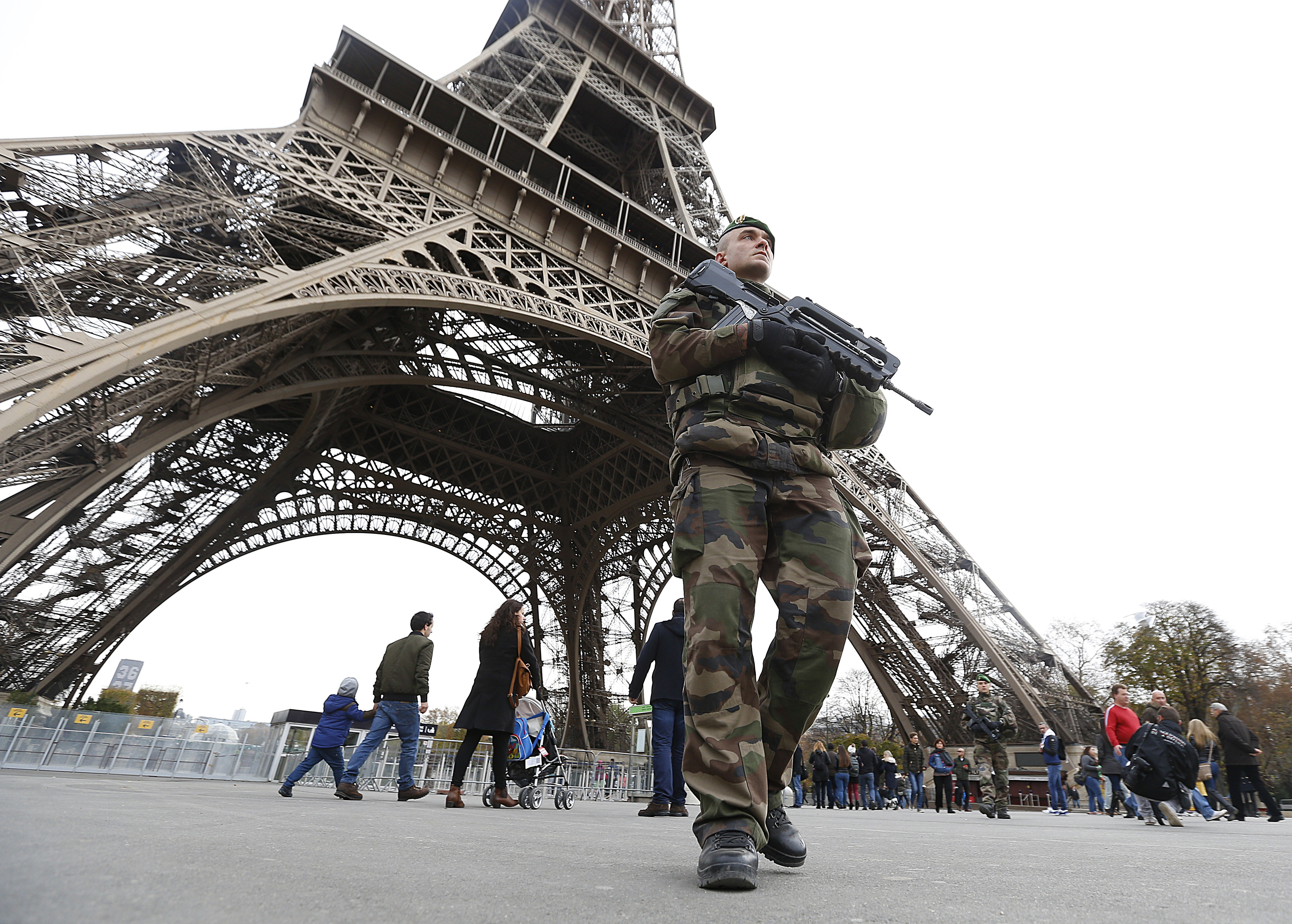 French military patrol near the Eiffel Tower the day after a series of deadly attacks in Paris, Nov. 14, 2015.