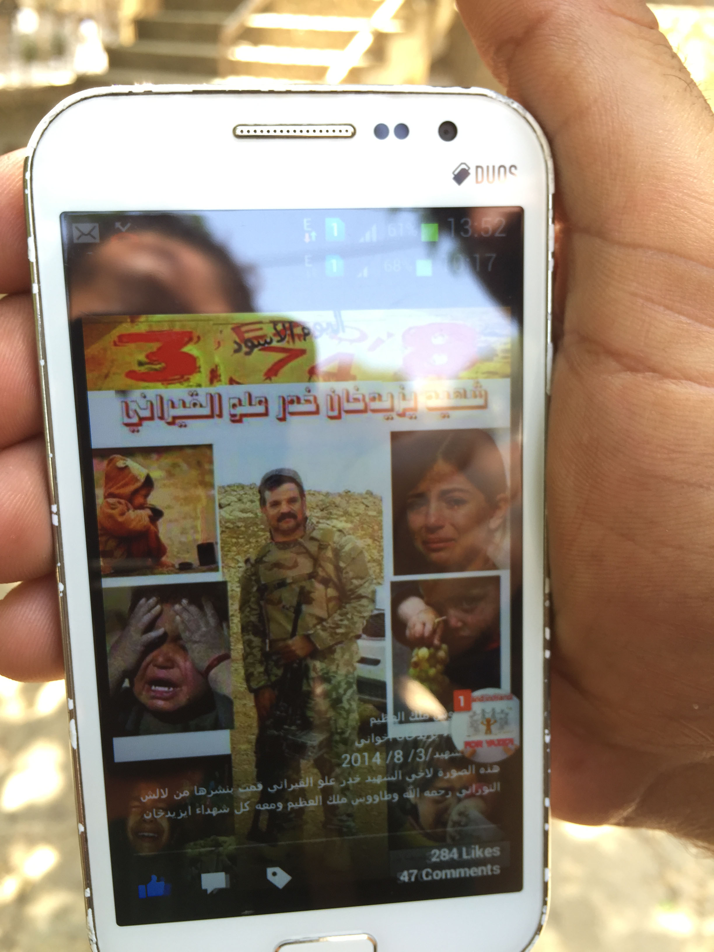 Moorad Aloo shows a picture of his brother who stayed behind to fight Islamic State militants in August 2014 when the extremists launched an assault against the religious minority. Aloo never saw his brother again. Lalish, Iraq, July 31, 2015. (Photo...