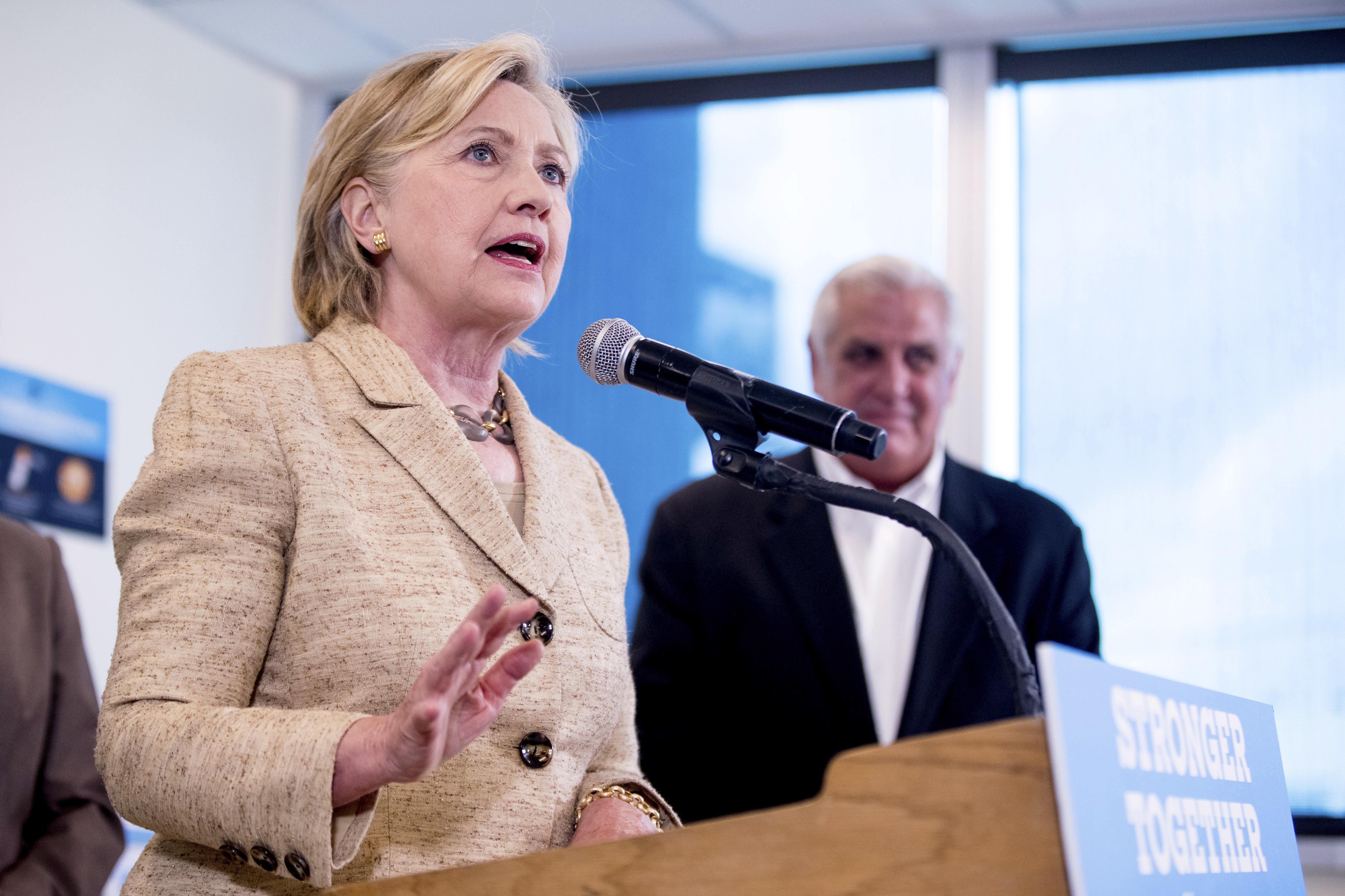 Democratic presidential candidate Hillary Clinton speaks to medical professionals after taking a tour of Borinquen Health Care Center, in Miami, Florida, Aug. 9, 2016, to see how they are combatting Zika.