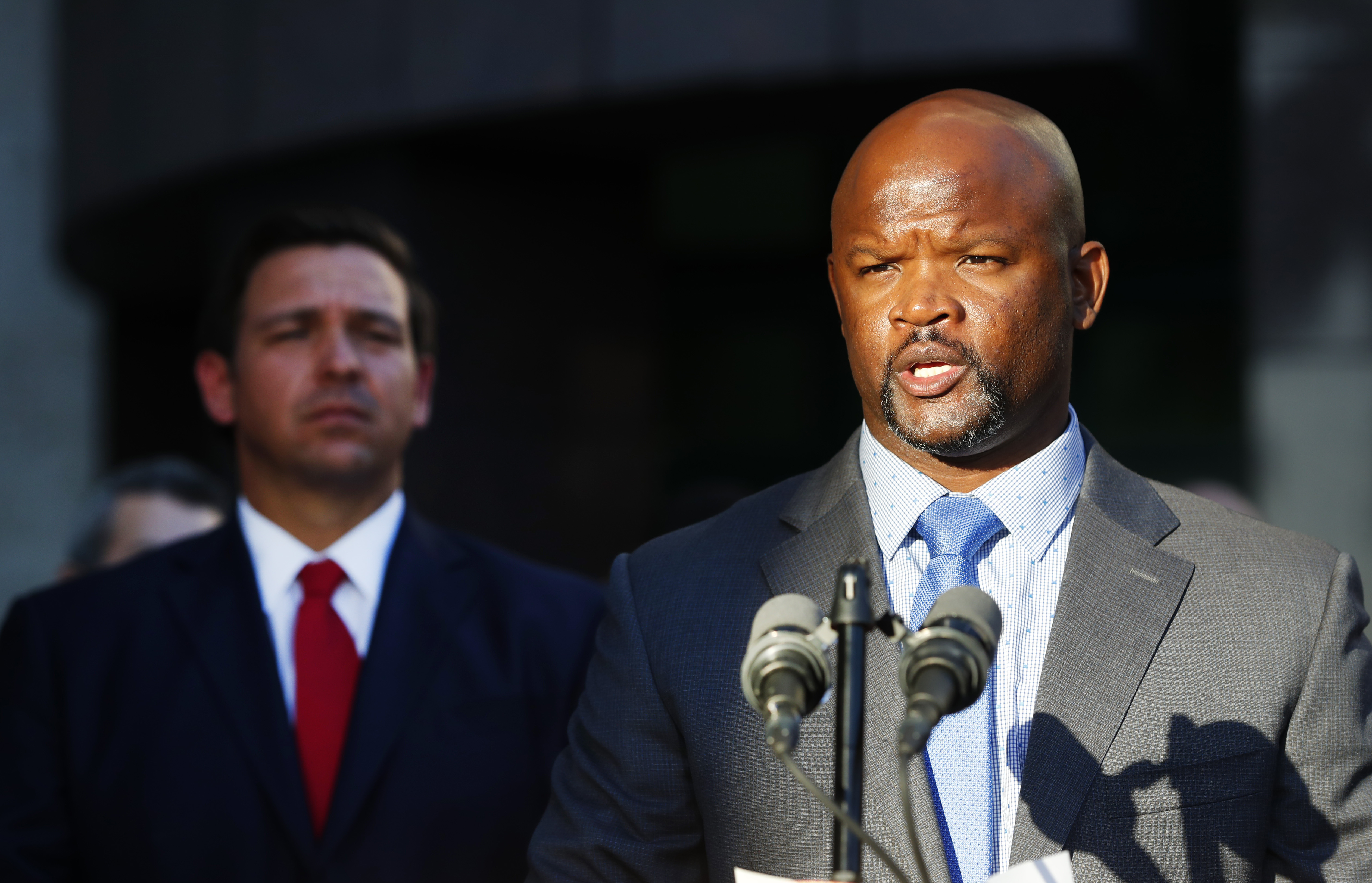 Acting sheriff Gregory Tony, right, speaks after being introduced by Florida Gov. Ron DeSantis, left, at the Broward County Sheriff's Office Fort Lauderdale headquarters in Florida, Jan. 11, 2019.