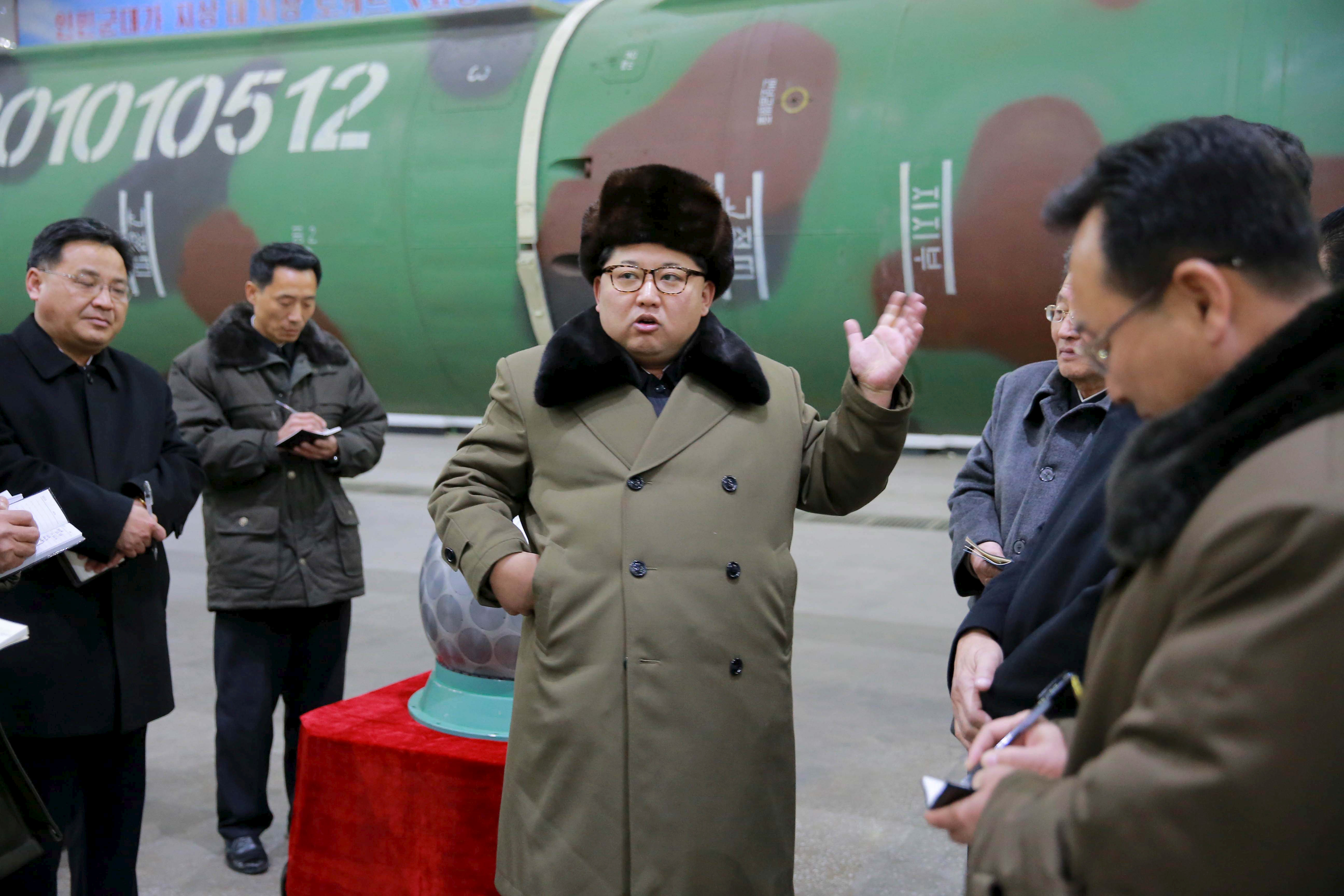 North Korean leader Kim Jong Un meets scientists and technicians in the field of research into nuclear weapons in this undated photo released by North Korea's Korean Central News Agency (KCNA), in Pyongyang, March 9, 2016.