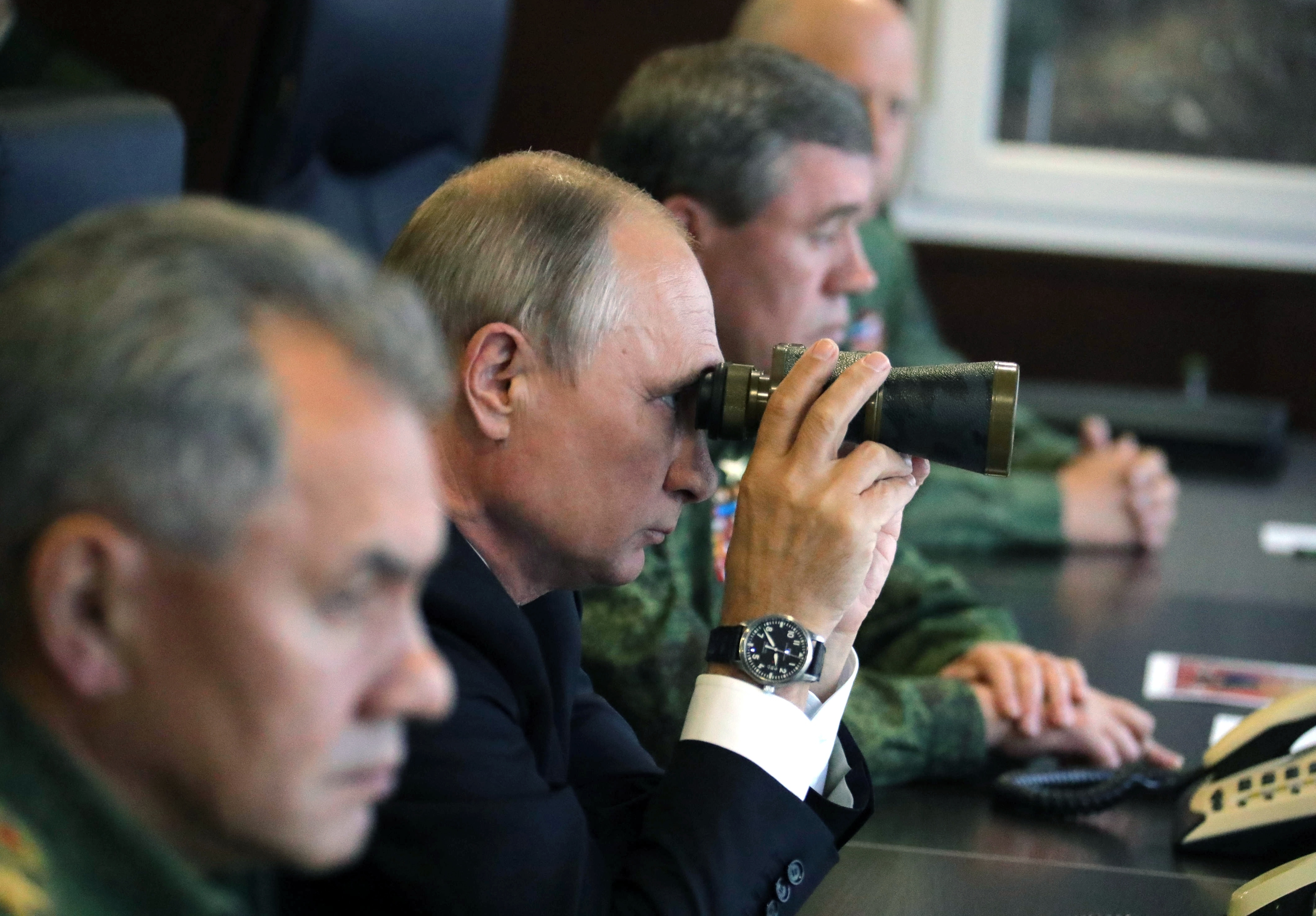FILE - Russian President Vladimir Putin, center, Defense Minister Sergei Shoigu, left, and Chief of the General Staff of the Russian Armed Forces Valery Gerasimov, right, watch a military exercise at a training ground at the Luzhsky Range, near St. P...