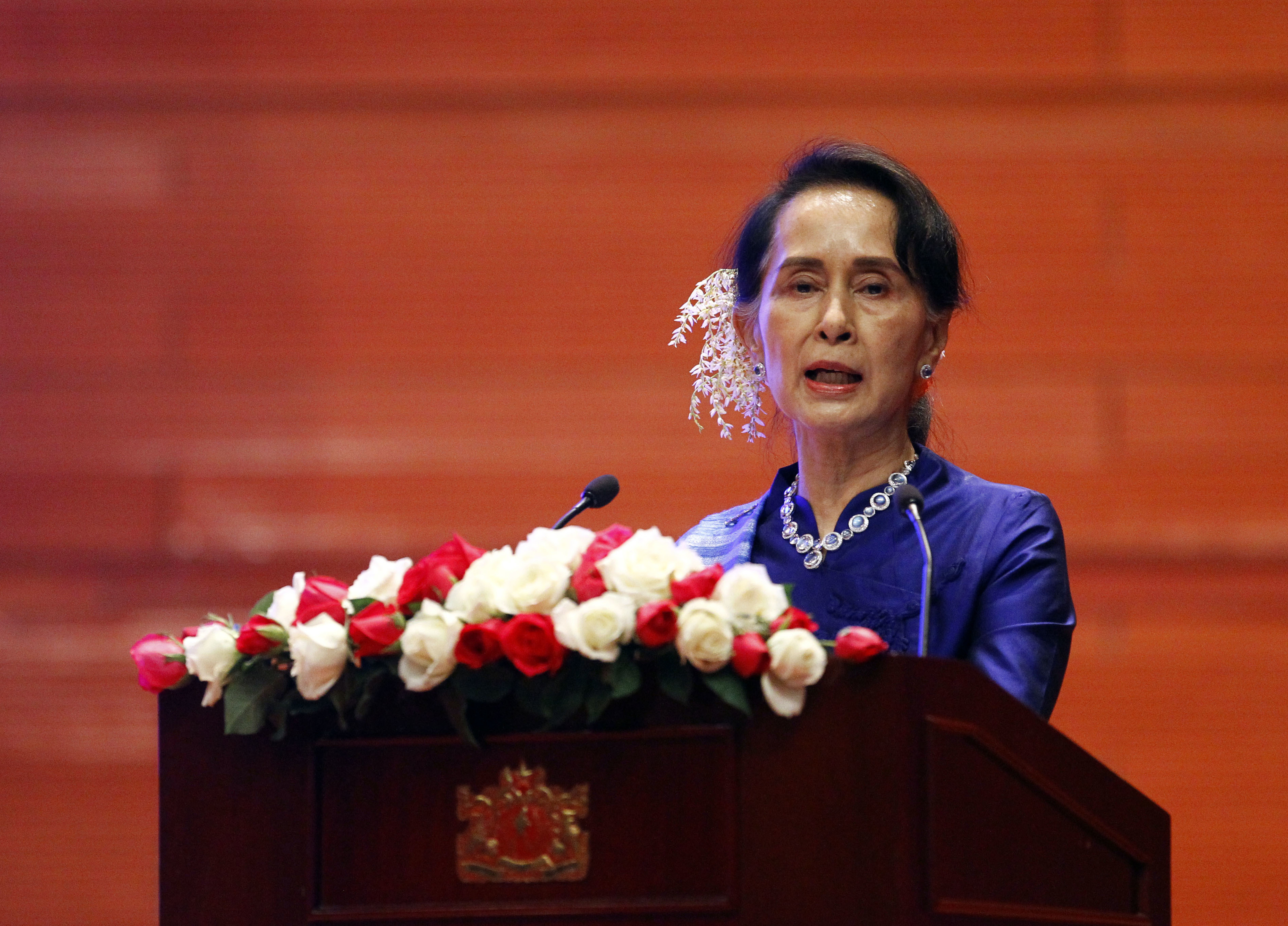 """Myanmar's leader Aung San Suu Kyi speaks during the signing ceremony of """"Nationwide Ceasefire Agreement"""" at Myanmar International Convention Center in Naypyitaw, Myanmar, Feb. 13, 2018."""