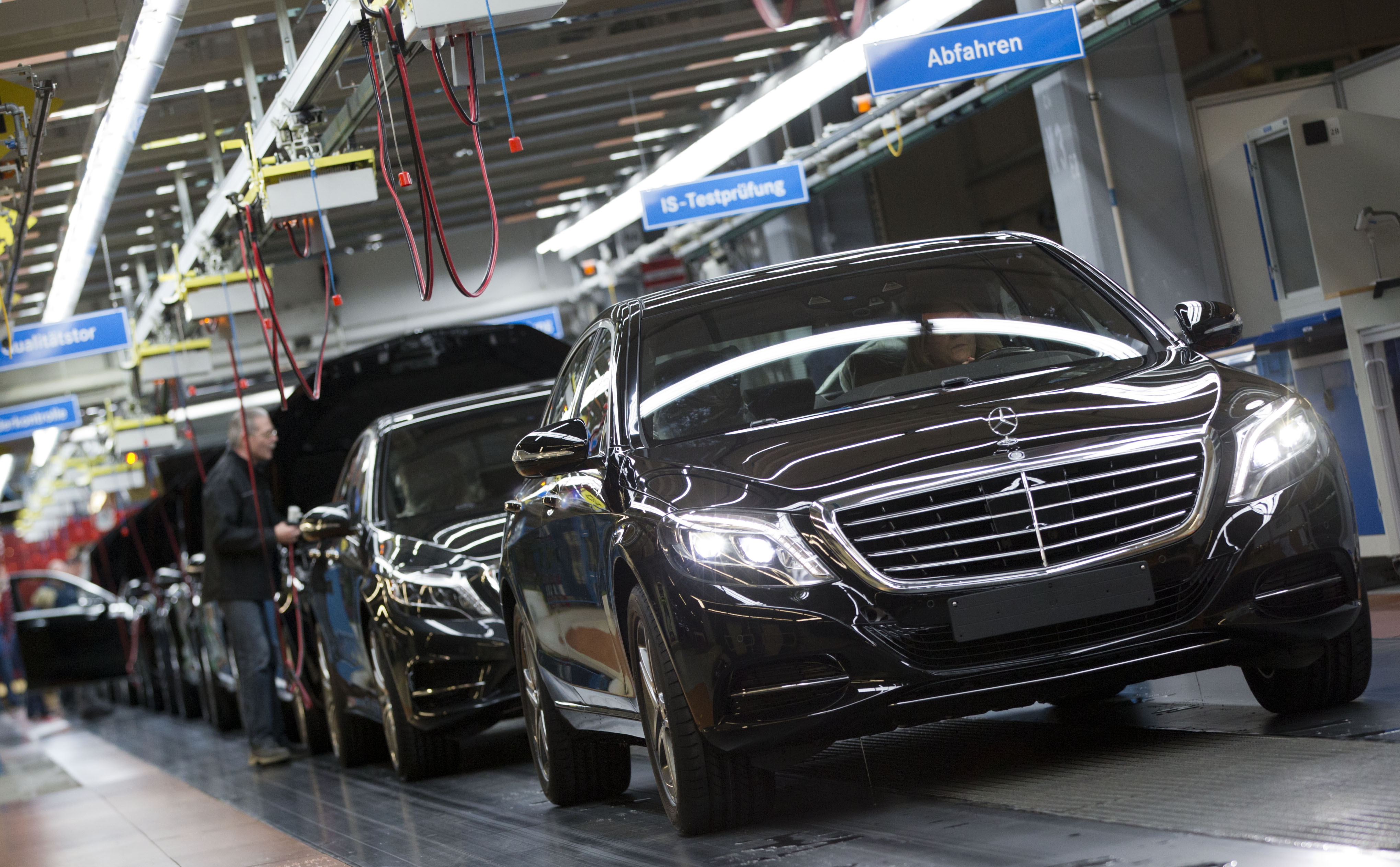 FILE - A Mercedes-Benz AG employee checks a S-Class model at the plant in Sindelfingen, Germany, Jan. 28, 2015. The pact between the world's largest maker of premium cars and the world's largest automotive supplier forms a powerful counterweight to r...