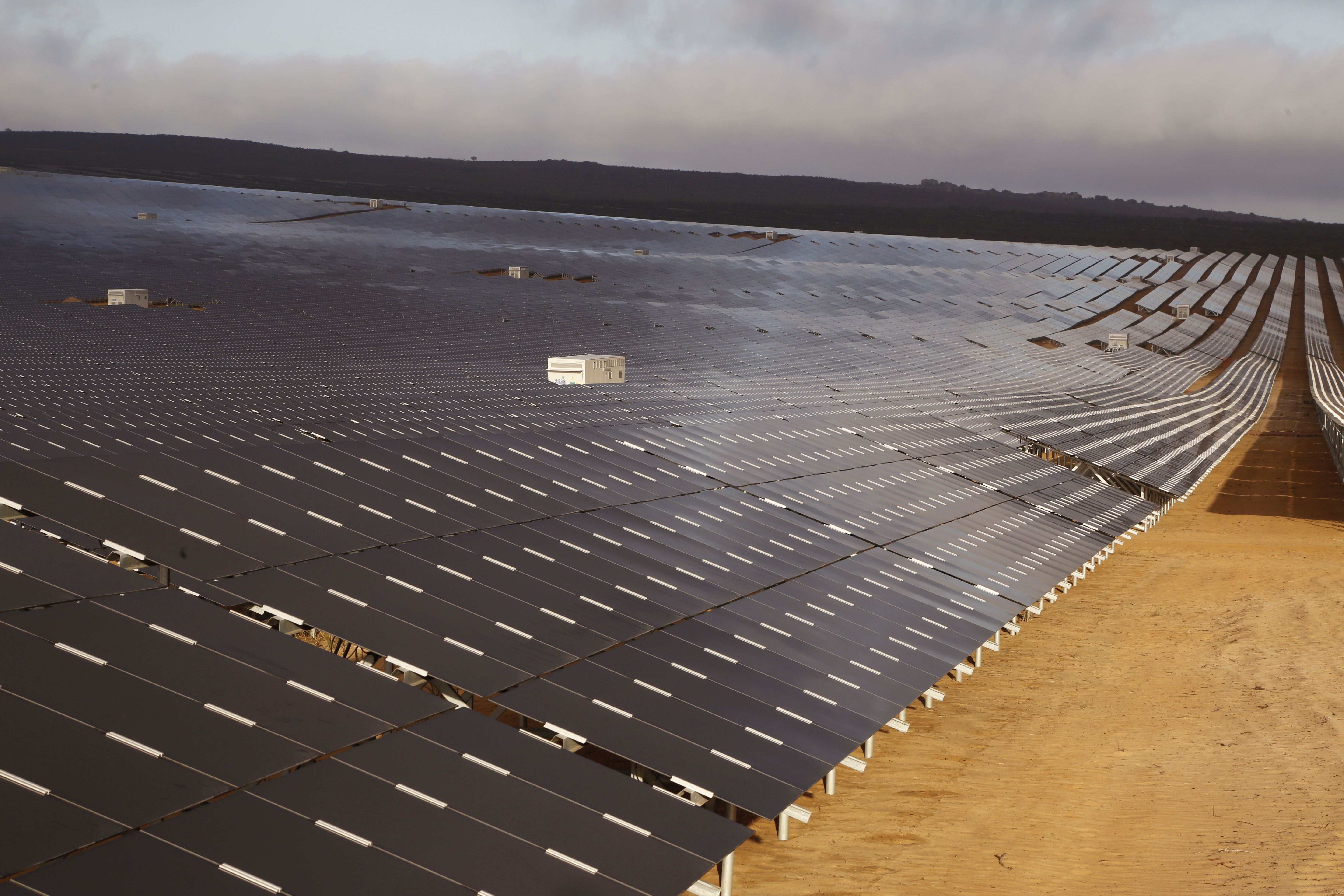 FILE - A photovoltaic solar park situated on the outskirts of the coastal town of Lamberts Bay, South Africa on March. 29,  2016.