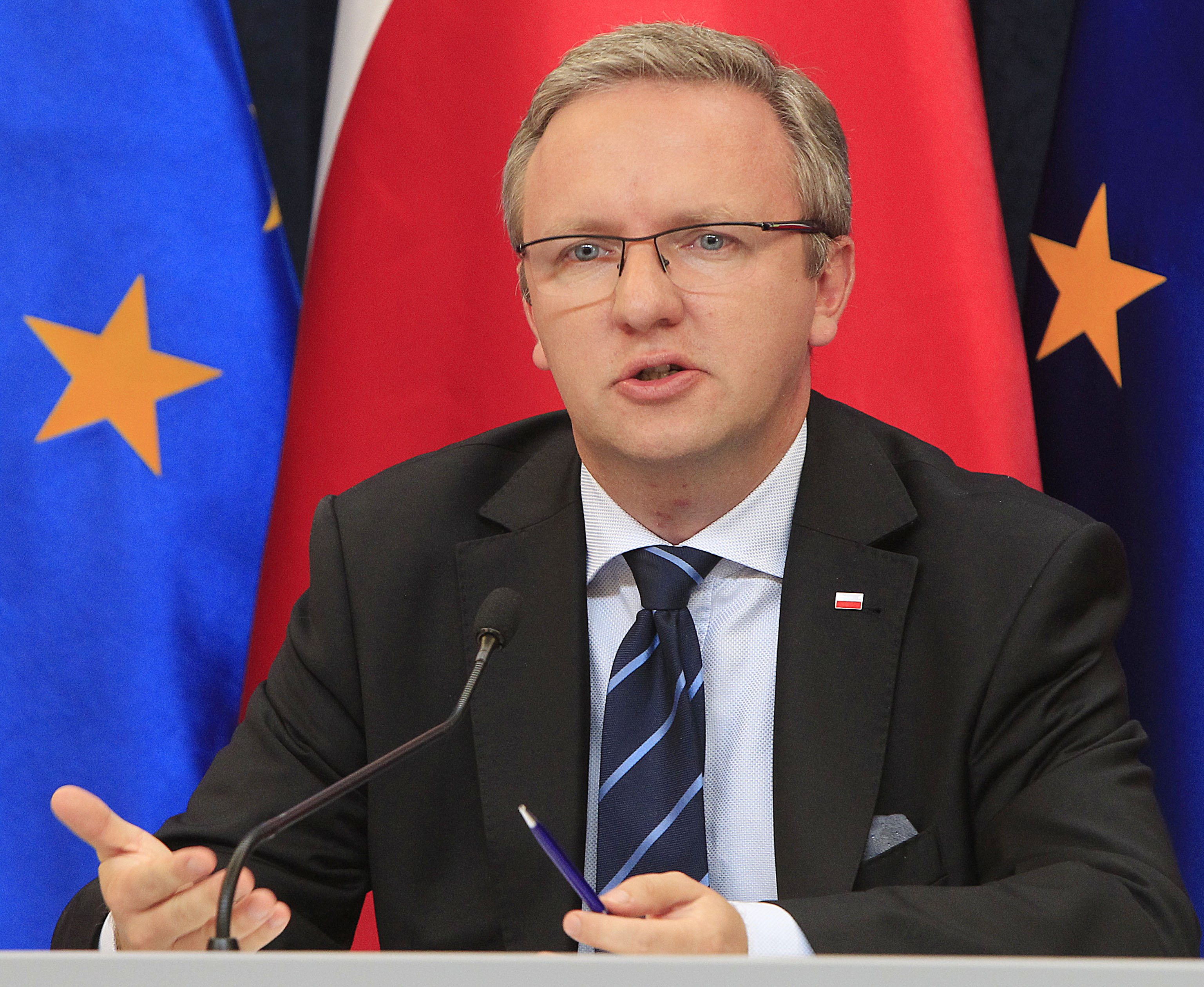 FILE - Krzysztof Szczerski, the foreign policy adviser of Polish President Andrzej Duda, speaks during a news conference at the Presidential Palace in Warsaw, Poland, Aug. 17, 2015.